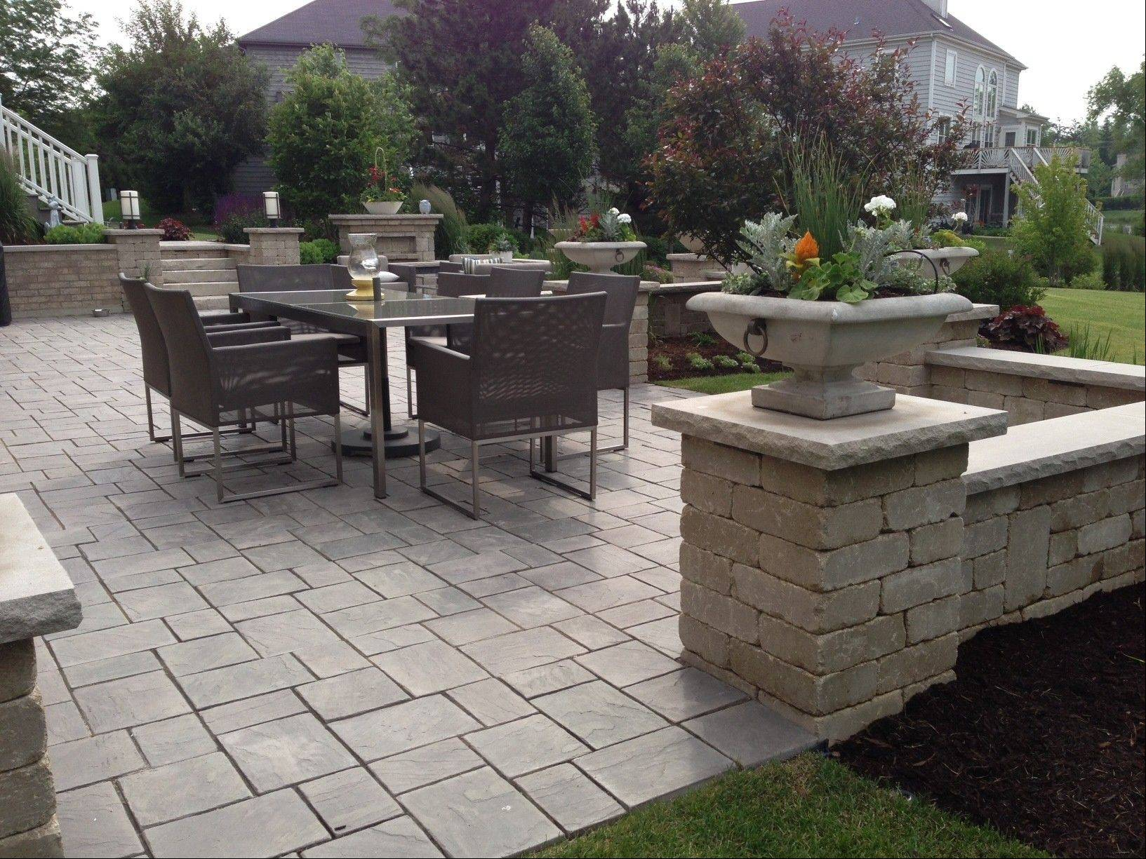 Pavers and retaining walls have become a popular alternative to wooden decks.
