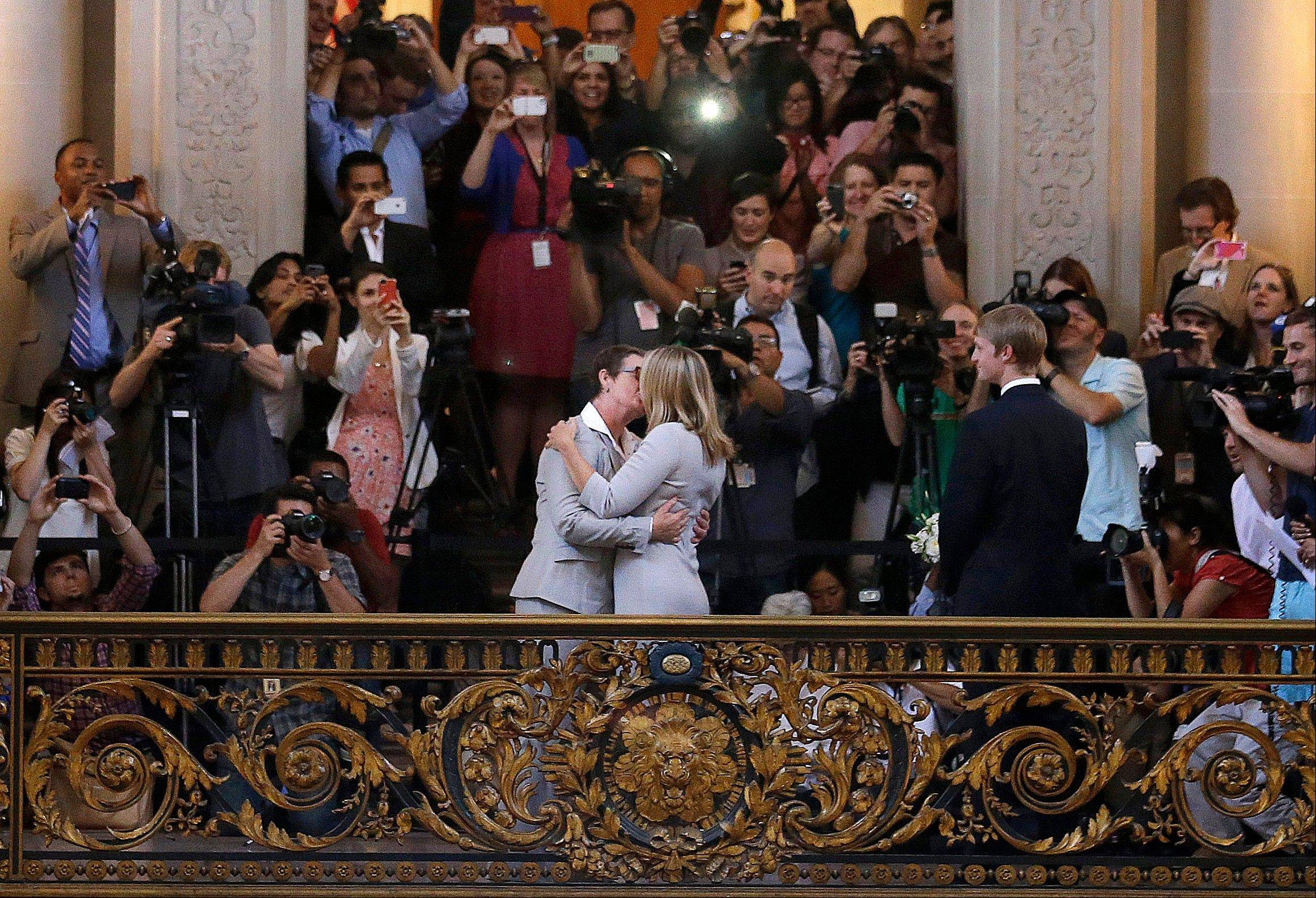 Kris Perry, foreground left, kisses Sandy Stier Friday as they are married at City Hall in San Francisco.