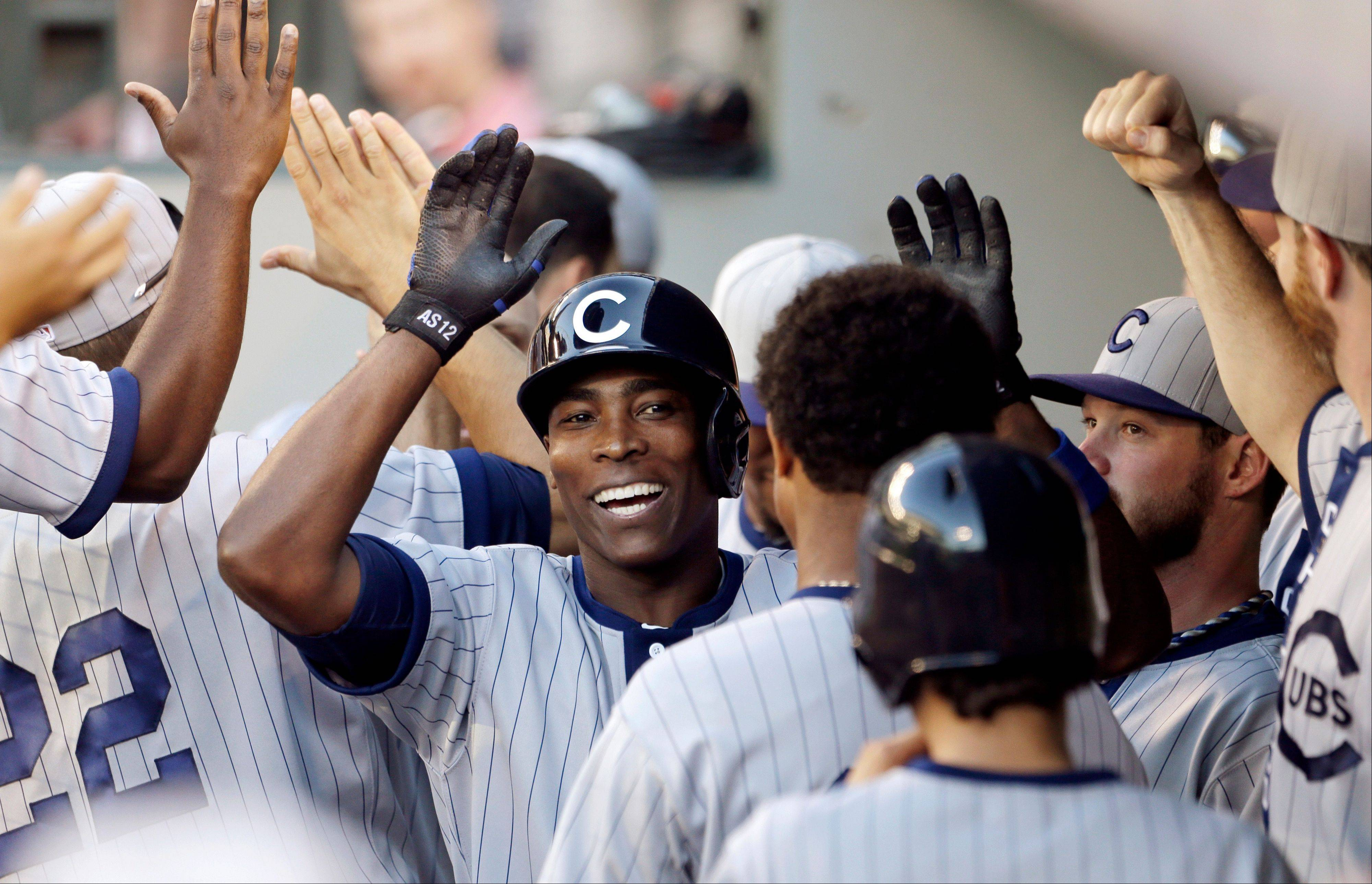 The Cubs' Alfonso Soriano gets congratulations for his two-run home run against the Seattle Mariners in the 11th inning of Saturday's game in Seattle. The Cubs won 5-3.