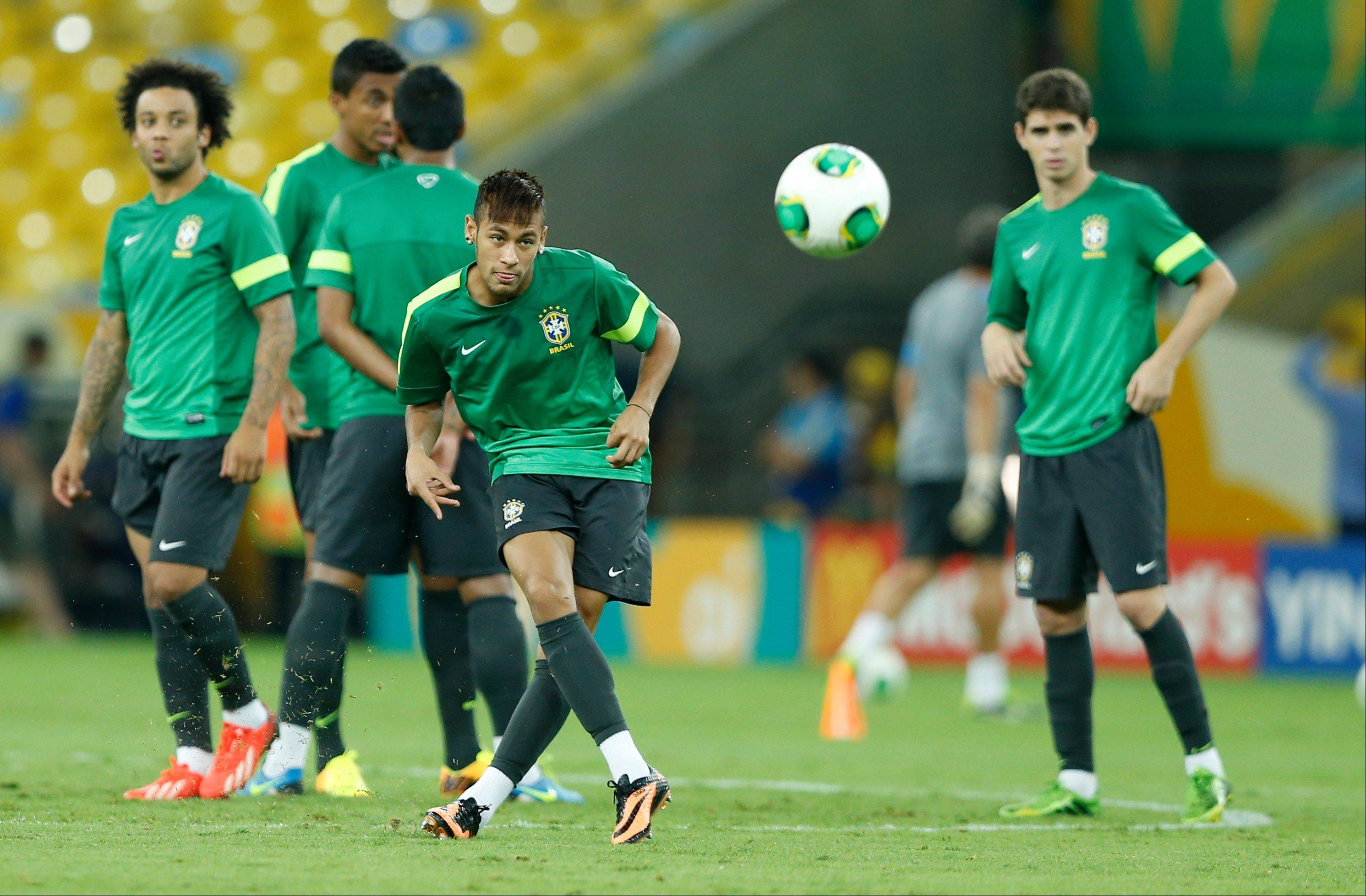 Brazil's Neymar kicks a ball during a training session of Brazil on the eve of the soccer Confederations Cup final match between Brazil and Spain at Maracana stadium in Rio de Janeiro, Brazil, Saturday, June 29, 2013. (AP Photo/Victor R. Caivano)