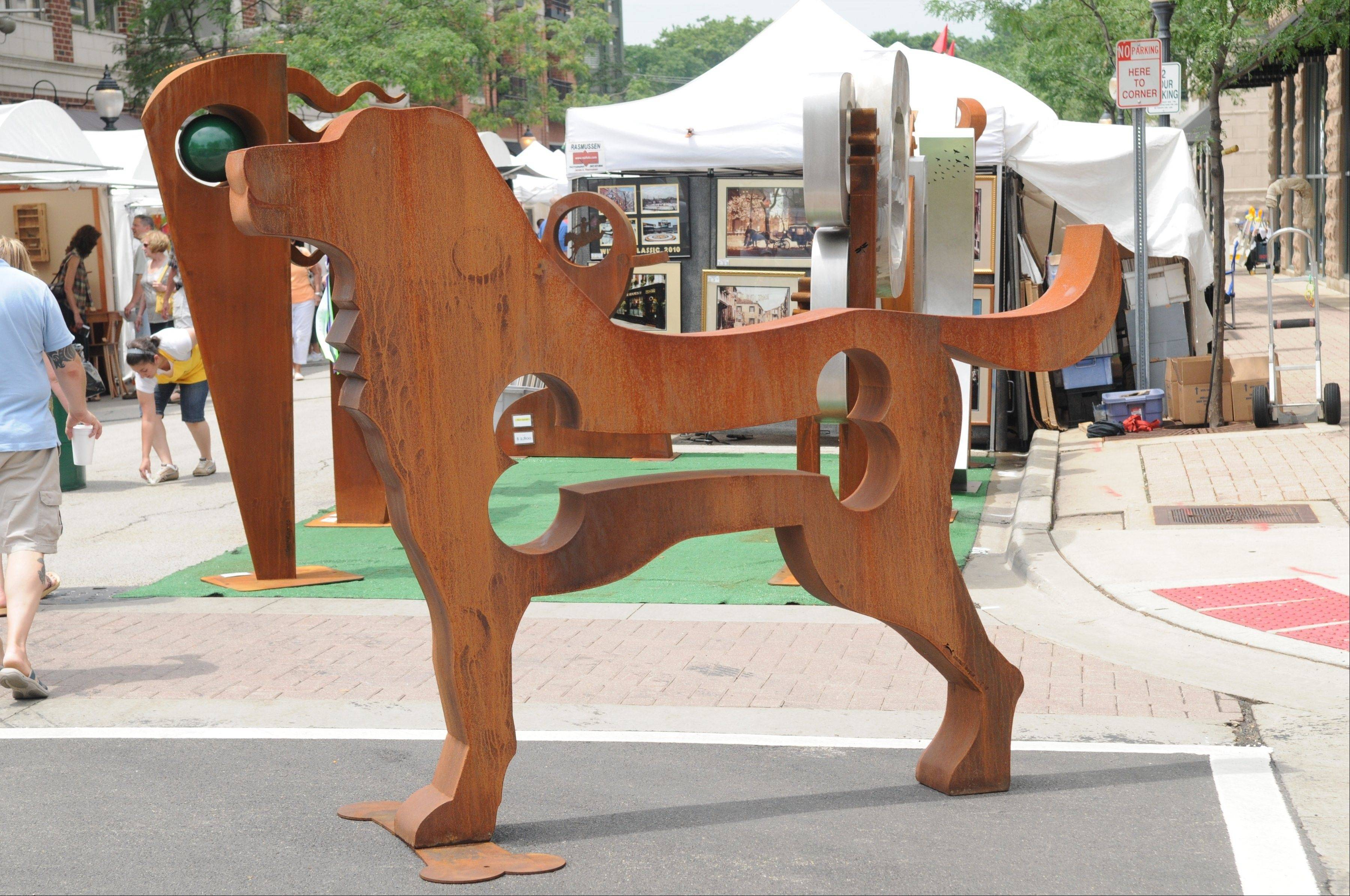"Dale Rogers' traveling outdoor sculpture art exhibit, ""Big Dog Show,"" is presented alongside other dog-related events during July around Highland Park."