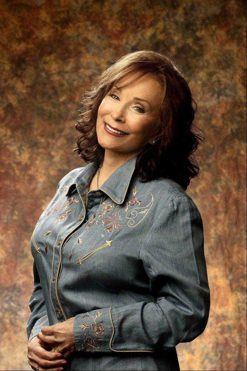Country music legend Loretta Lynn is set to perform on the same bill with Randy Travis at RiverEdge Park in Aurora.