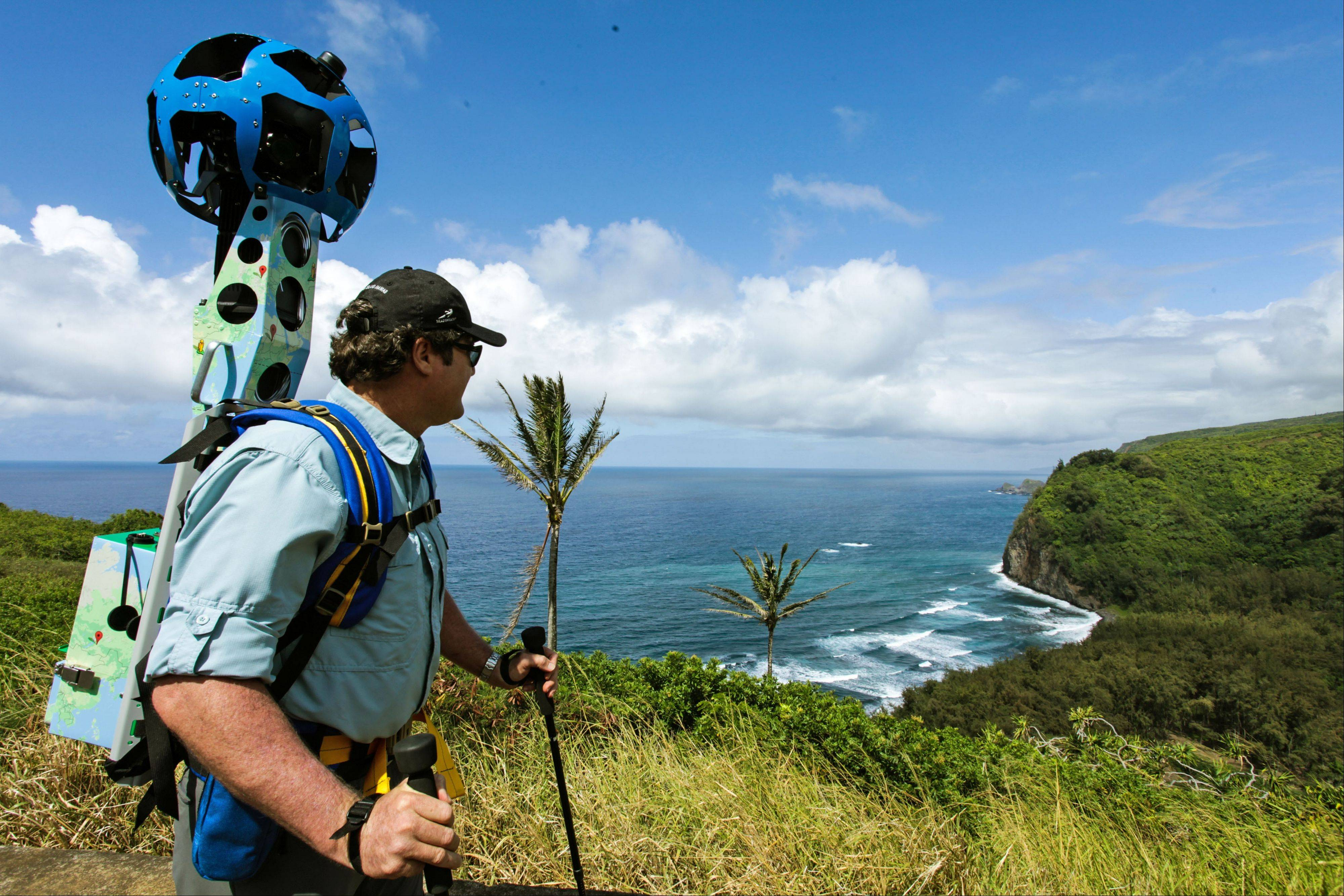 Rob Pacheco, president of Hawaii Forest & Trail, takes in the view at Pololu Valley's Awini Trail near Kapaau, Hawaii, while wearing the Street View Trekker. Hawaii's volcanoes, rain forests and beaches will soon be visible on Google Street View.