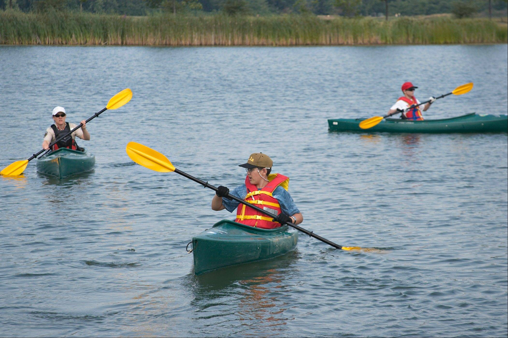 Students learn to kayak at Paddling Camp at Independence Grove through the Lake County Forest Preserve.
