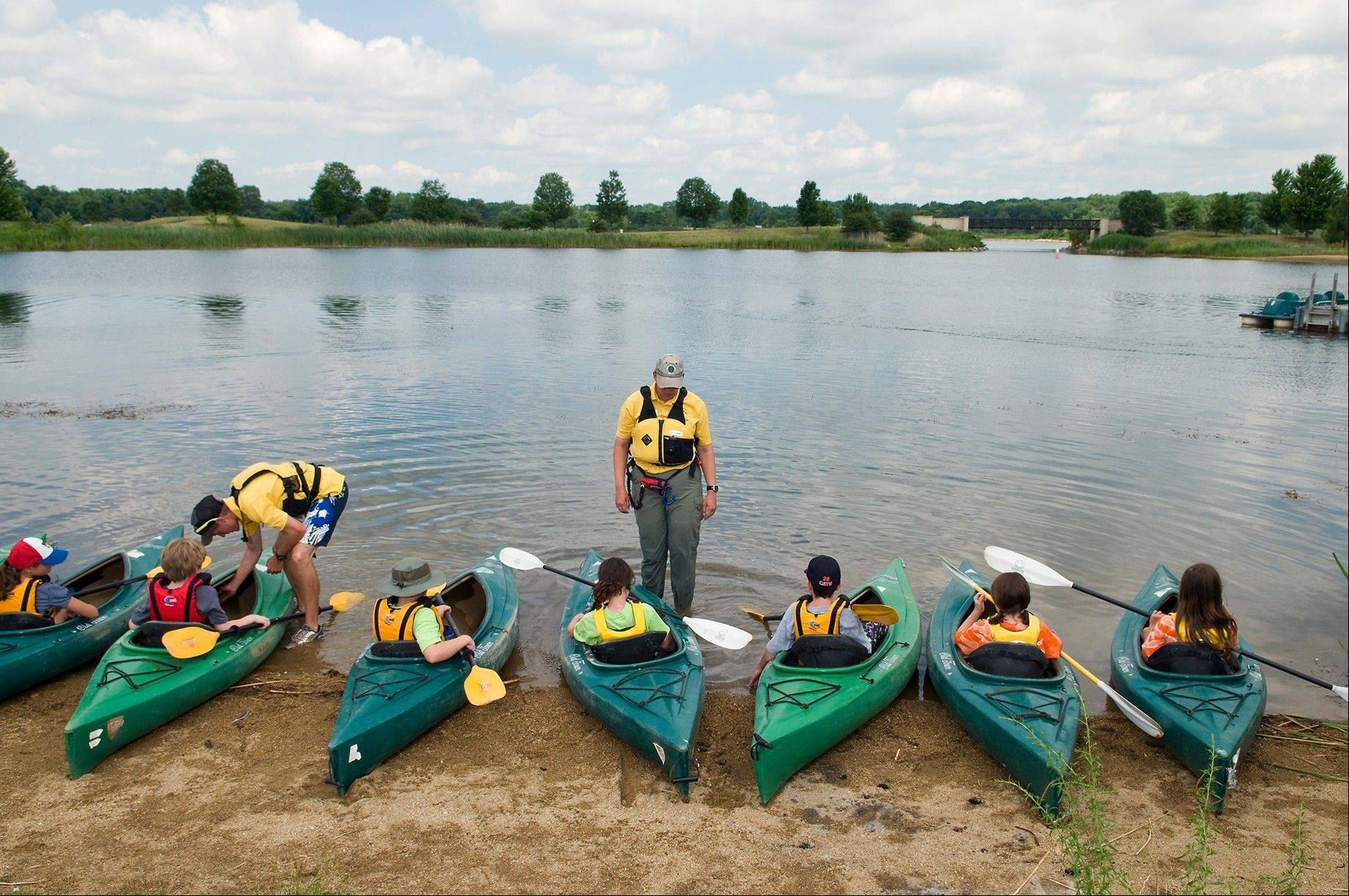 Paddle Camp instructor April Vaos teaches a kayaking class at Independence Grove in the Lake County Forest Preserve.