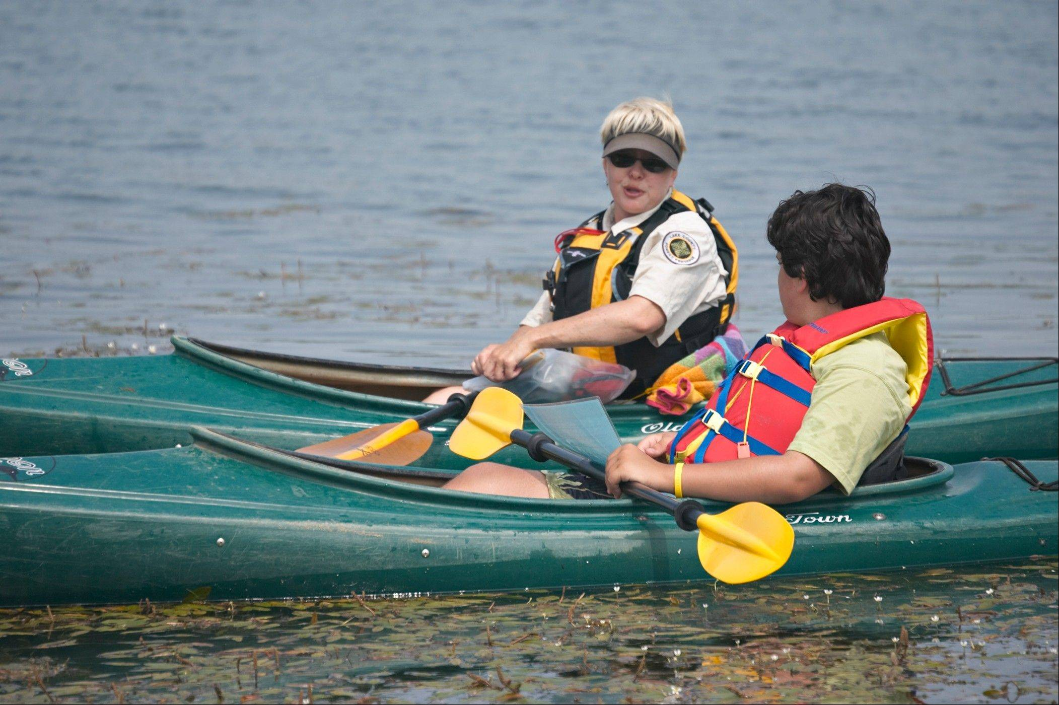 Paddling Camp instructor Jan Ward teaches kayaking at Independence Grove for the Lake County Forest Preserve.