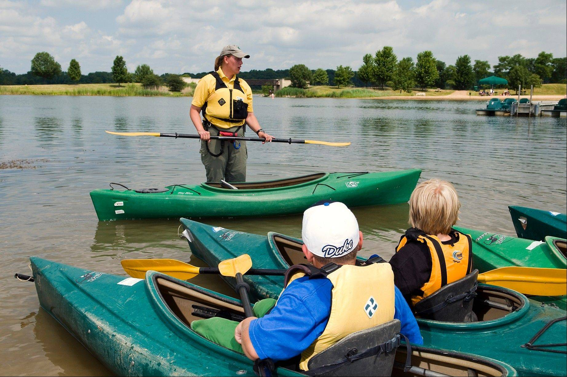 Adventures in Nature Camp instructor April Vaos teaches kayaking at Independence Grove at the Lake County Forest Preserve.