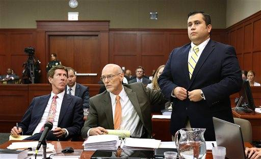 George Zimmerman, right, stands next to his attorneys, Mark O'Mara, left, and Don West, during the 15th day of his trial in Seminole circuit court, in Sanford, Fla., Friday, June 28, 2013. Zimmerman has been charged with second-degree murder for the 2012 shooting death of Trayvon Martin.