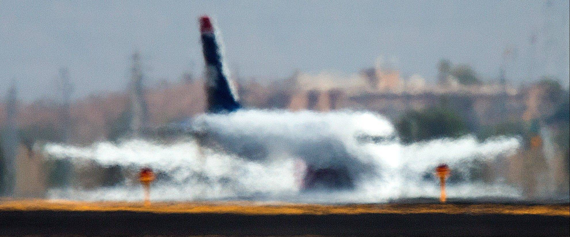 An airliner is distorted by the heat waves rising up from the north runway Friday at Sky Harbor International Airport in Phoenix.
