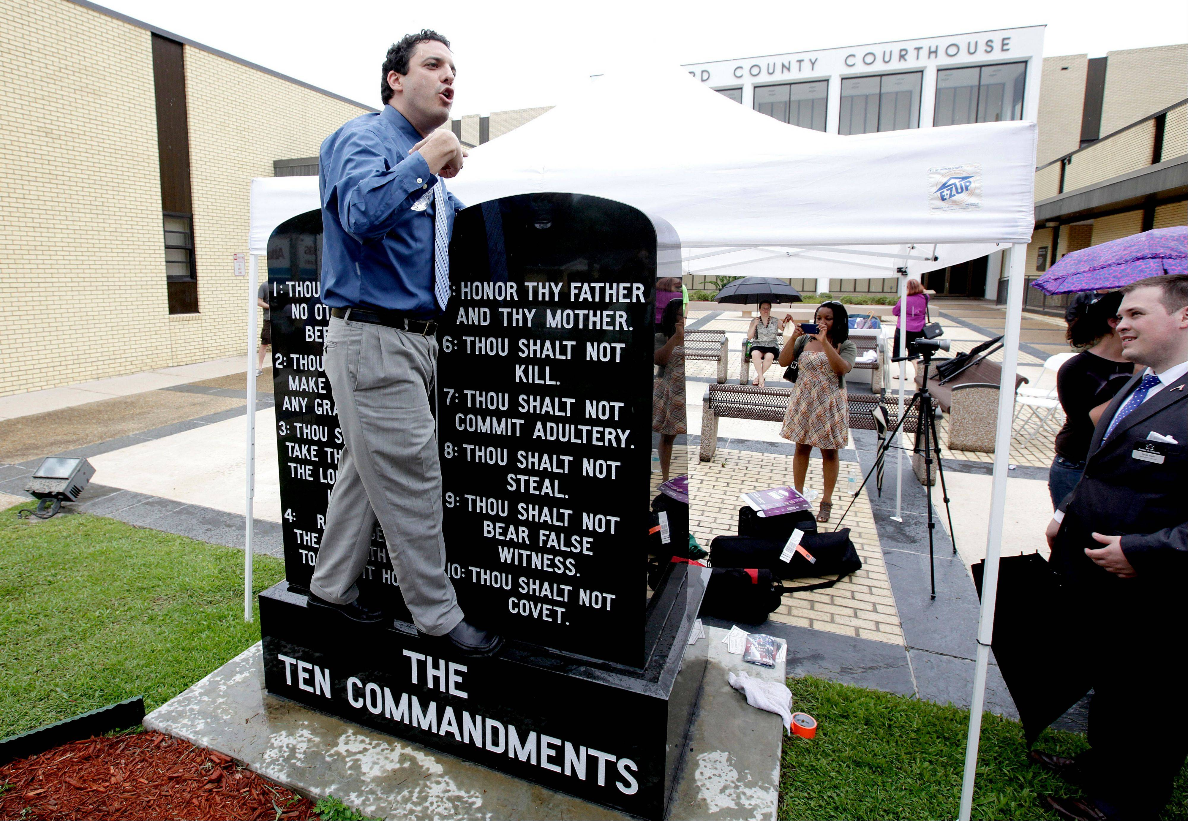 David Silverman, president of American Atheists, stands on a Ten Commandments and says why he thinks it shouldn't be there.