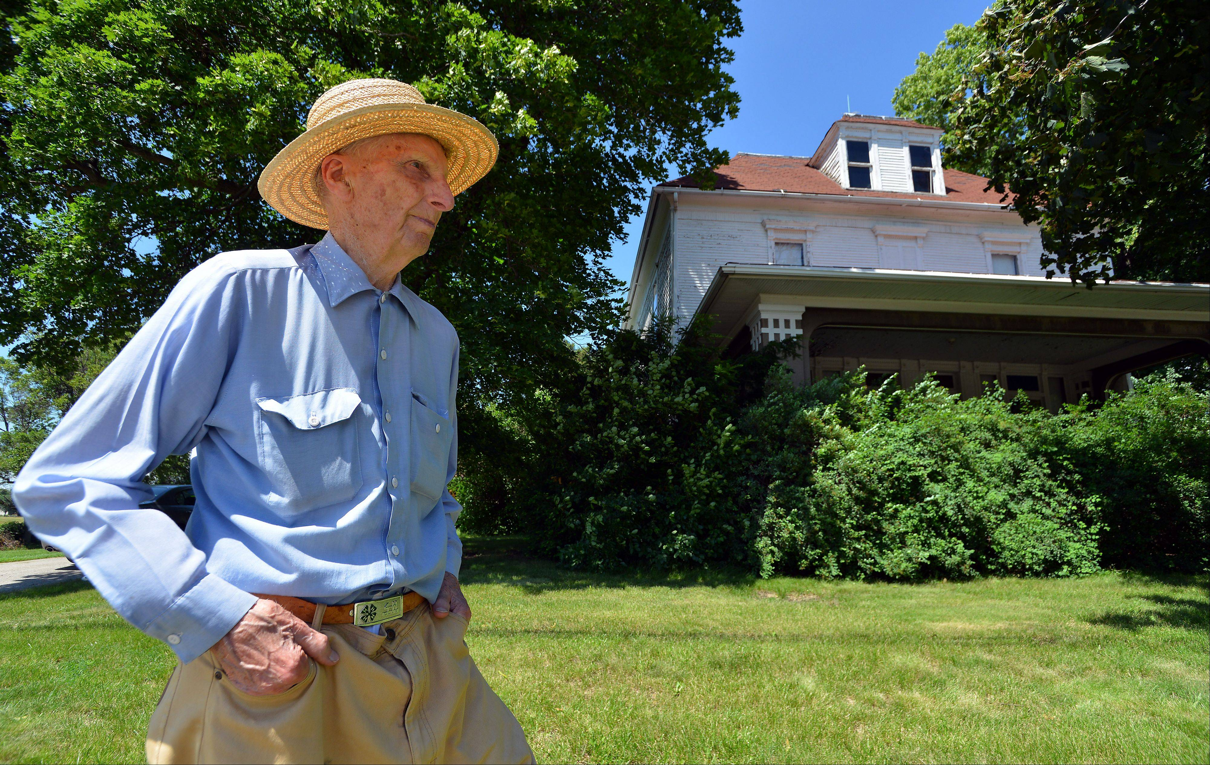 Harold Bergman, 97, of Hoffman Estates stands in front of the home in which he was born. He's the oldest farmer in Cook County. The Hoffman Estates Village Board proclaimed today Harold G. Bergman Day.
