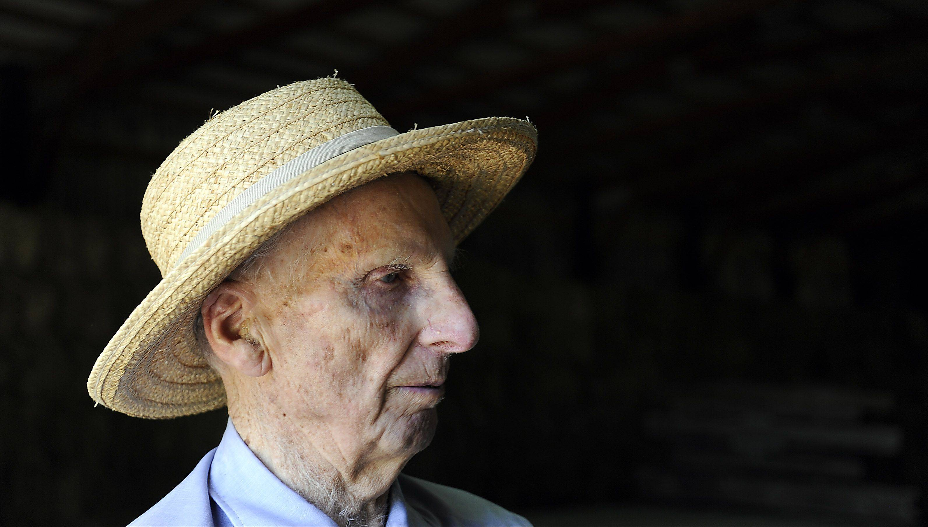 Harold Bergman, 97, of Hoffman Estates talks in his barn about being the oldest farmer in Cook County.