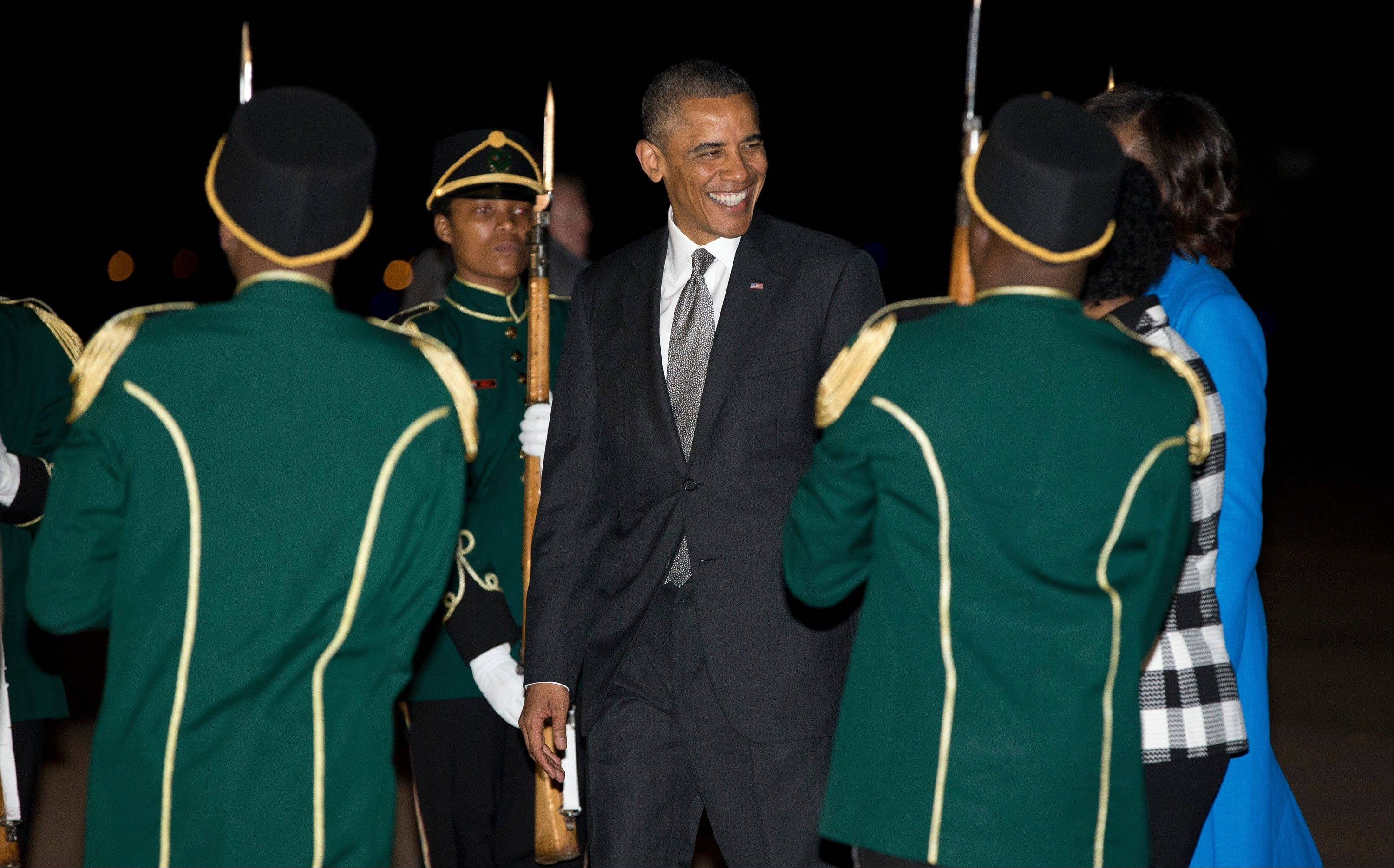 President Barack Obama and first lady Michelle Obama arrive Friday at Waterkloof Air Base, in Centurion, South Africa.