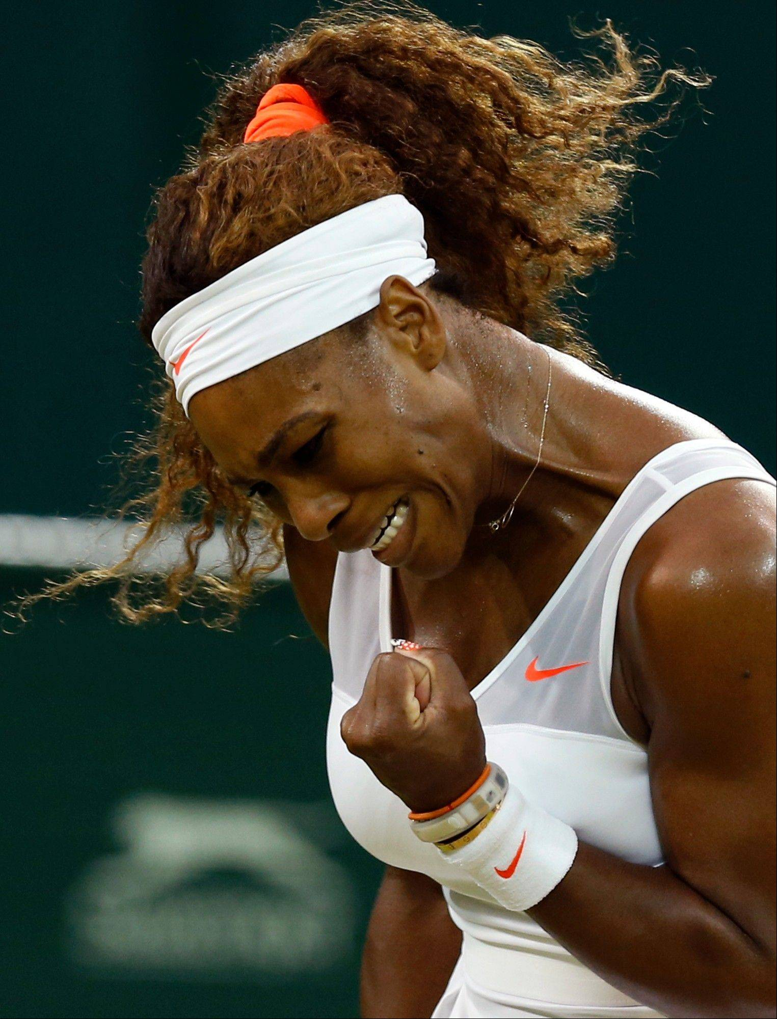 Serena Williams of the United States reacts after winning a point as she plays Kimiko Date-Krumm of Japan during their Women's singles match at the All England Lawn Tennis Championships in Wimbledon, London, Saturday, June 29, 2013.