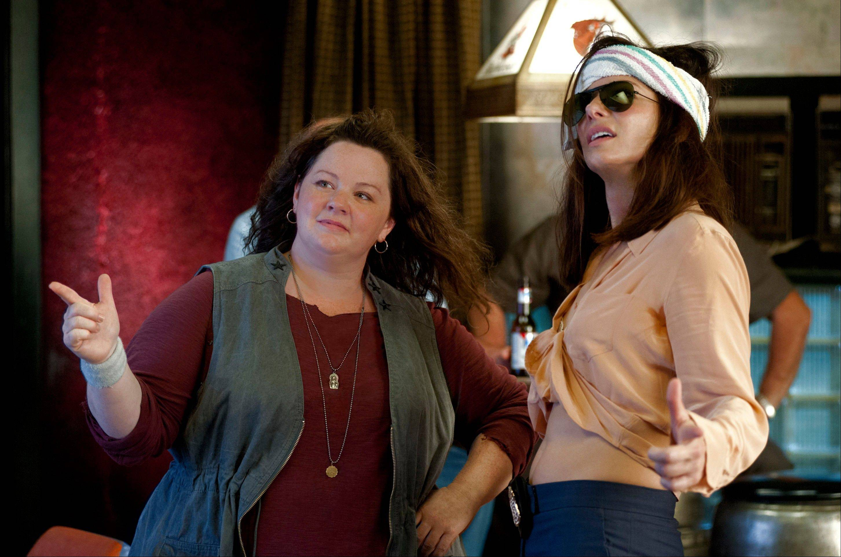 FBI Special Agent Sarah Ashburn (Sandra Bullock), right, teams up with bossy Boston Detective Shannon Mullins (Melissa McCarthy) in �The Heat.� The buddy-cop film brought in $40 million in its opening weekend in theaters.