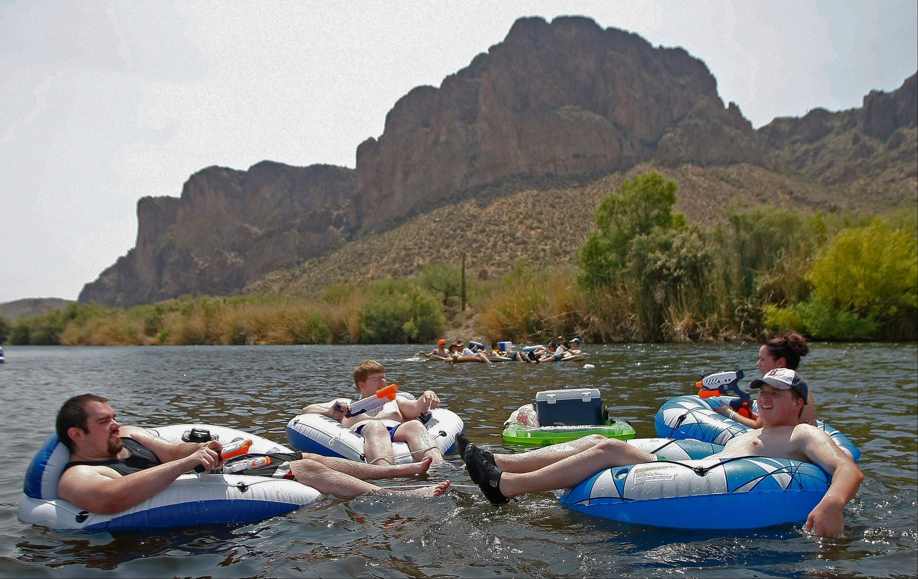 Tubers float down the Salt River on Saturday in Phoenix. Excessive heat warnings will continue for much of the Desert Southwest as building high pressure triggers major warming in eastern California, Nevada and Arizona. Temperature�s are expected to get as high as 118 degrees.