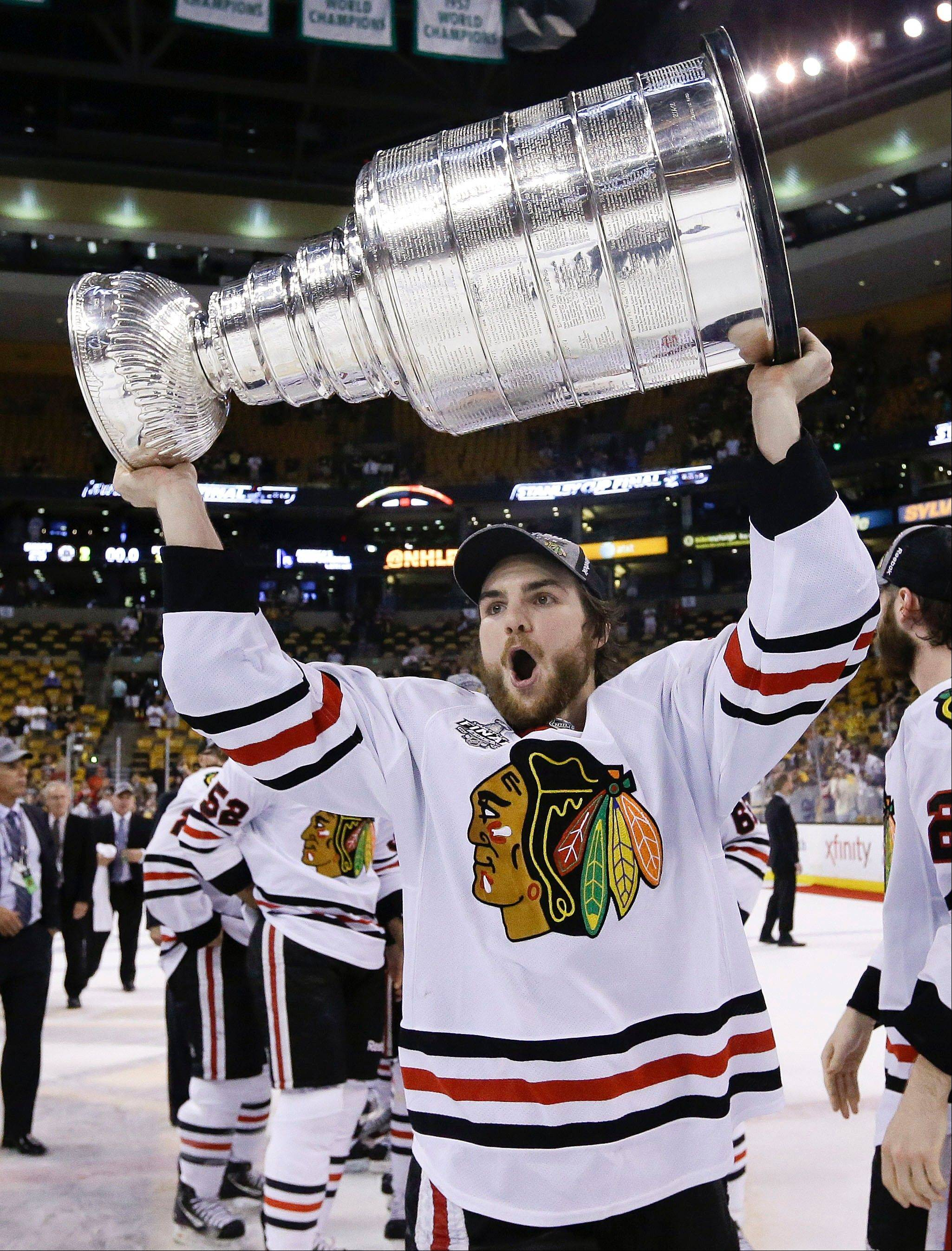 Michael Frolik hoists the Stanley Cup after the Blackhawks beat the Boston Bruins 3-2 in Game 6 last Monday.