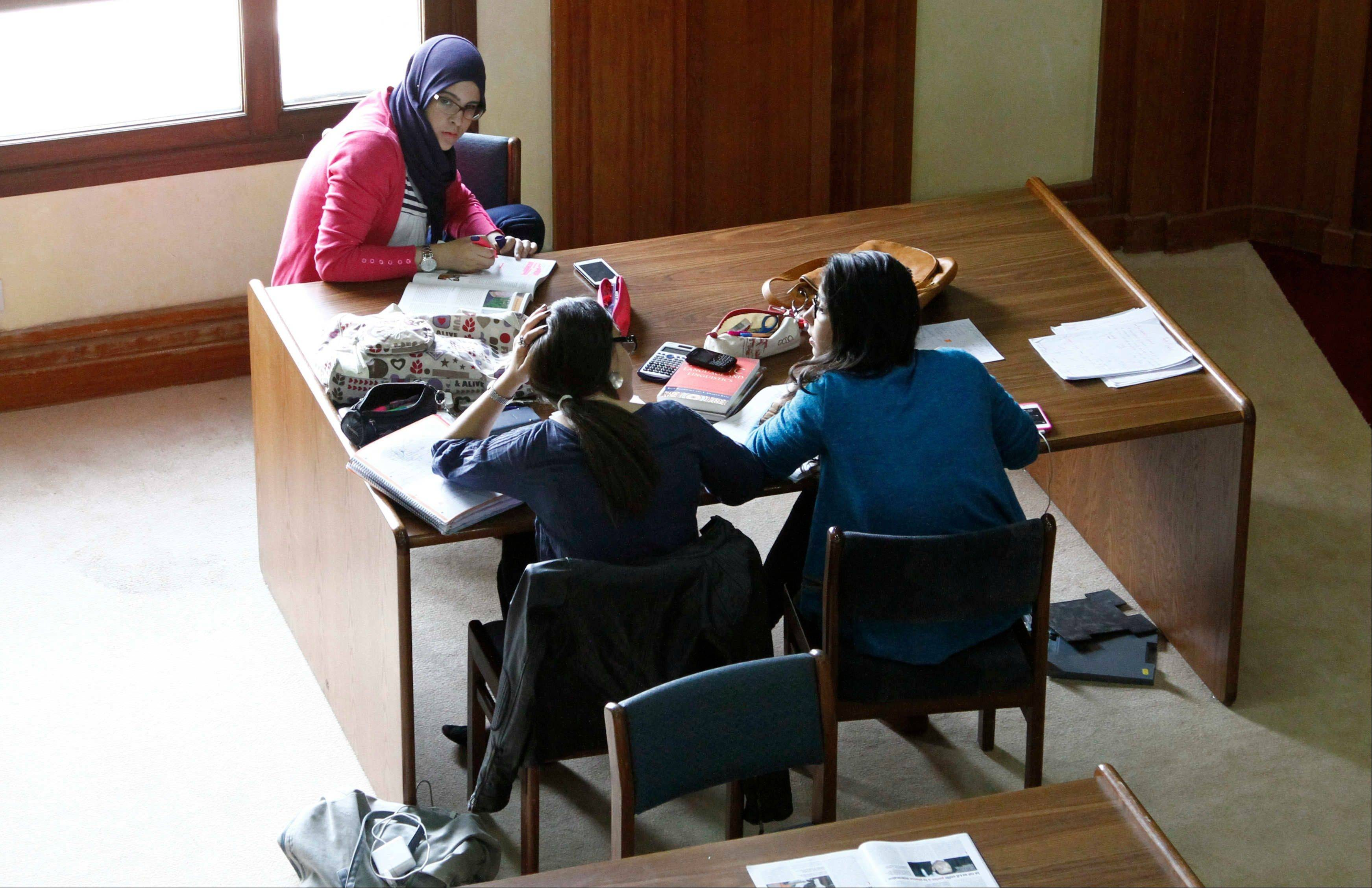 Students engage in group study at the Al Akhawayn University library, in Ifrane, Morocco. Morocco's public universities follow the traditional French model of early and strict separation of subjects. Al Akhawayn follows the model of St. John's College in New Mexico, which offers a �great books� curriculum based on the foundations of Western literature.