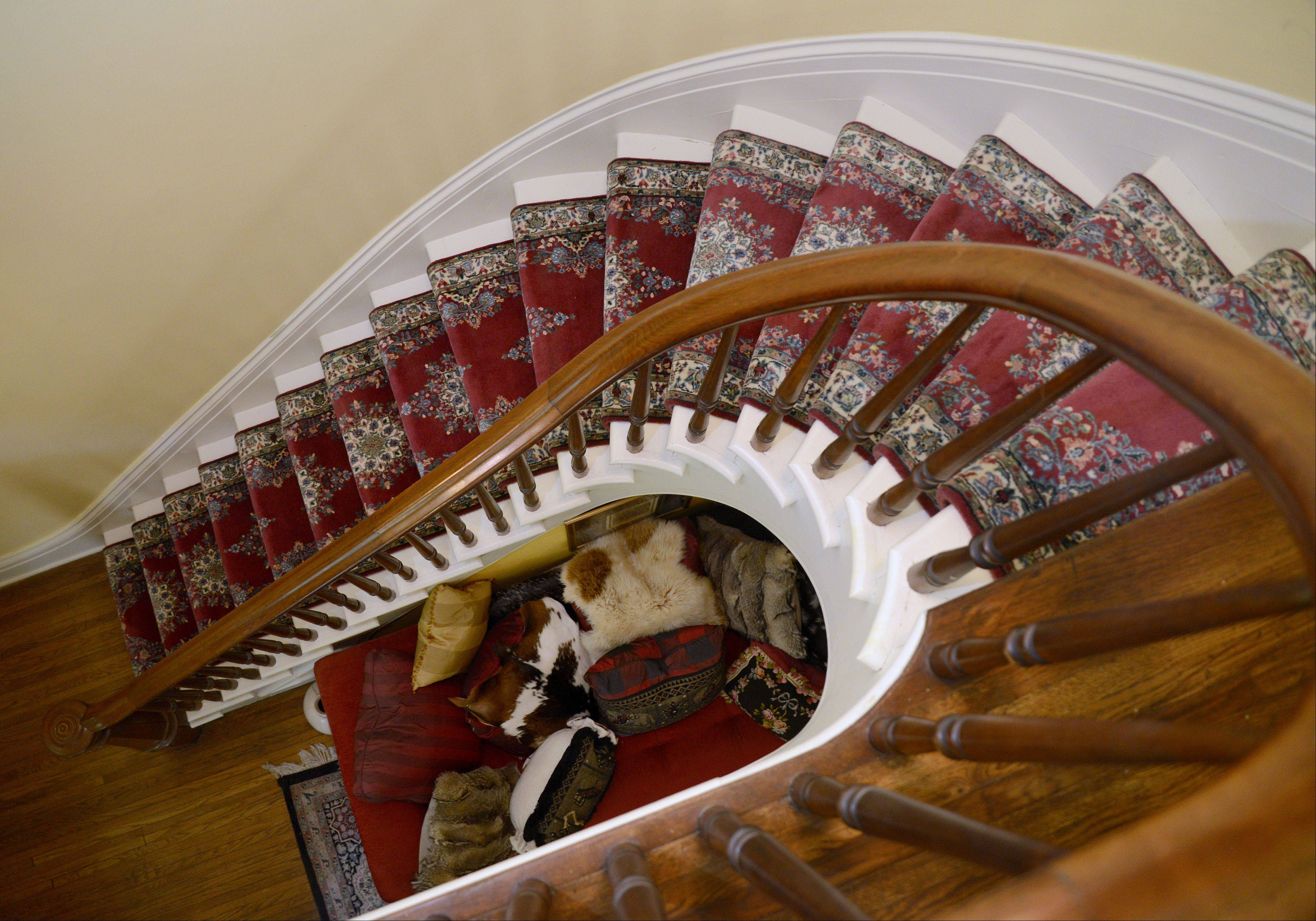 The winding staircase from the living room to the second floor in the historic Curtis house in Geneva.