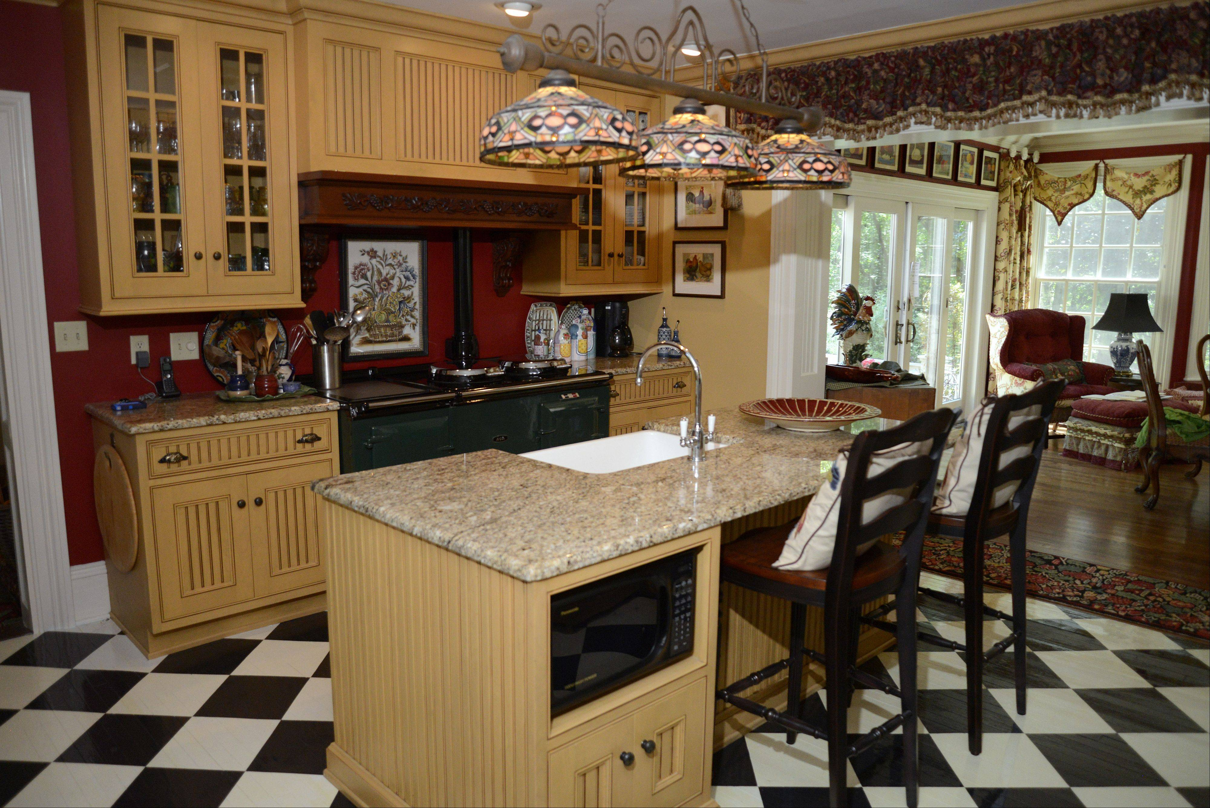 The kitchen of the historic Curtis house in Geneva features granite countertops and an AGA cooker.