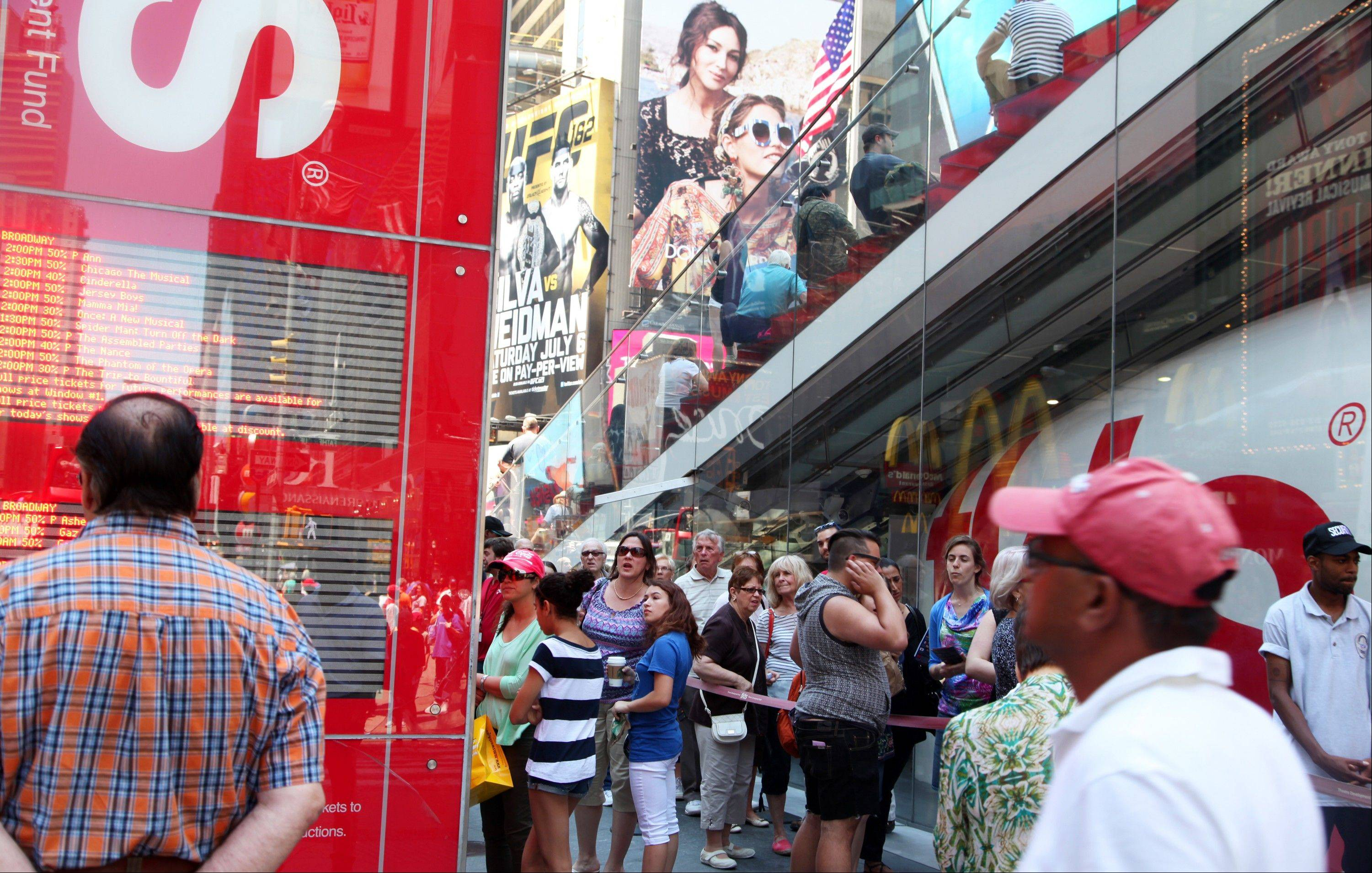 Crowds gather outside the TKTS booth in Times Square in New York. The booth, which offers same-day discount Broadway and off-Broadway tickets, turns 40 this summer.