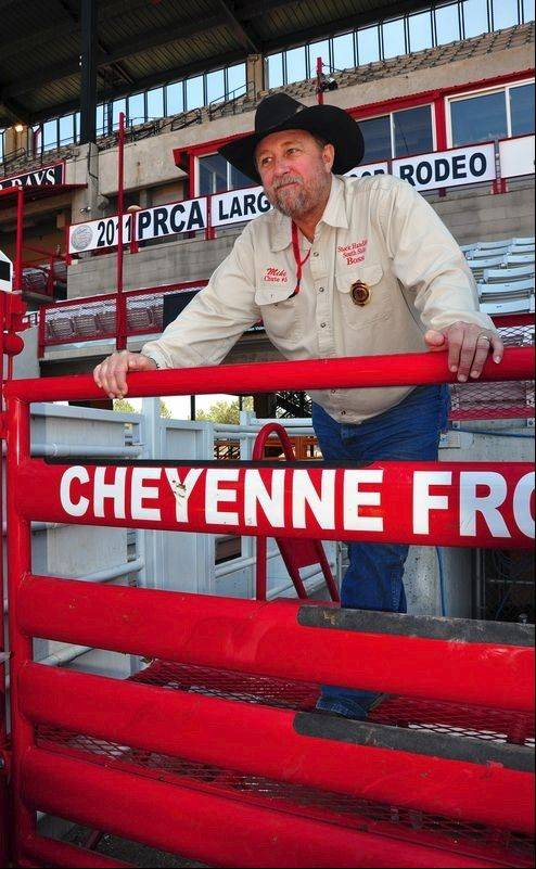 Stock handlers man the Cheyenne Chutes, invented in Cheyenne. The device opens sideways, making a safer exit for both cowboys and animals.