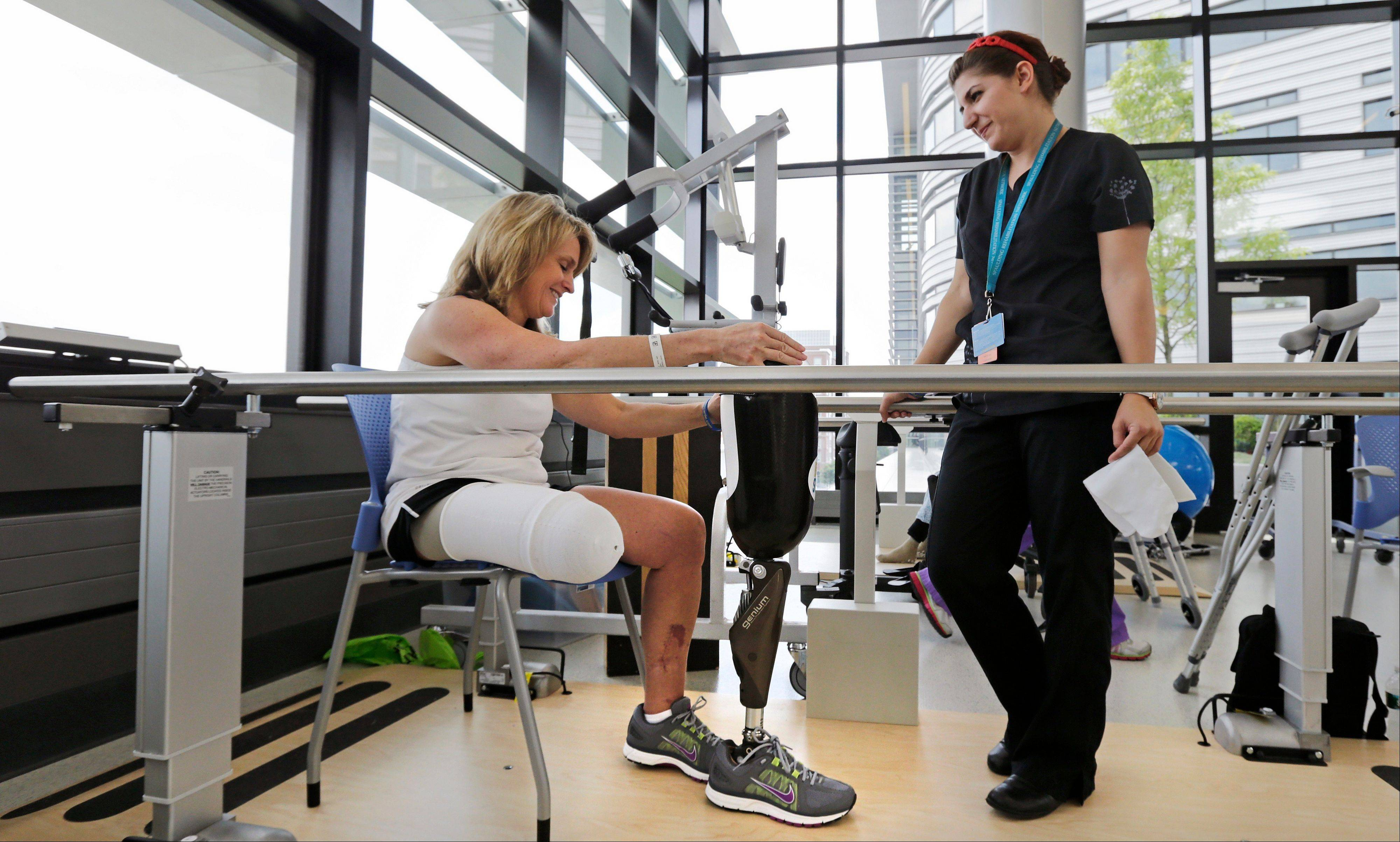Boston Marathon bombing survivor Sdoia talks with physical therapist Dara Casparian.