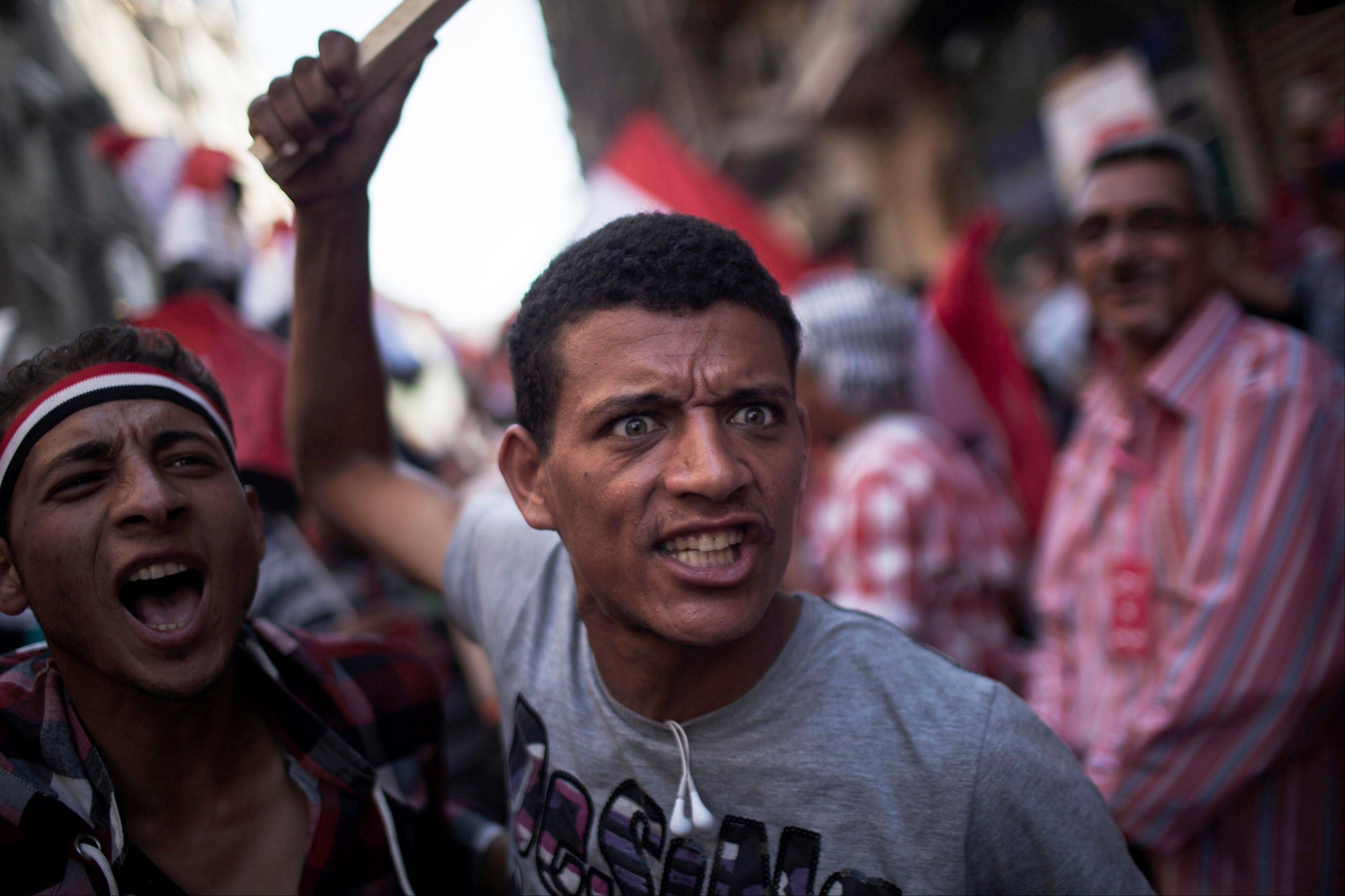 An Egyptian protester chants slogans against President Mohammed Morsi during a rally Sunday in Tahrir Square in Cairo.
