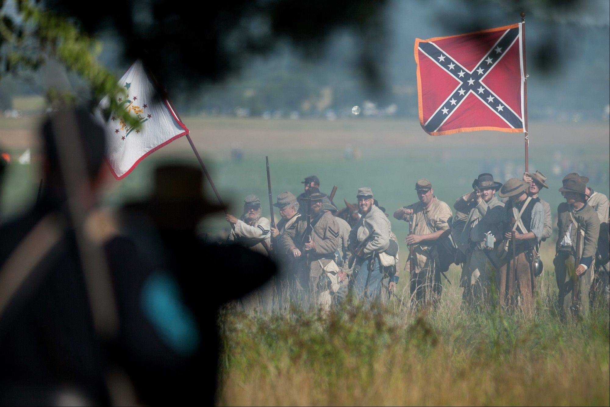 Reenactors participate in a demonstration of a battle Saturday during the 150th anniversary of the Battle of Gettysburg.