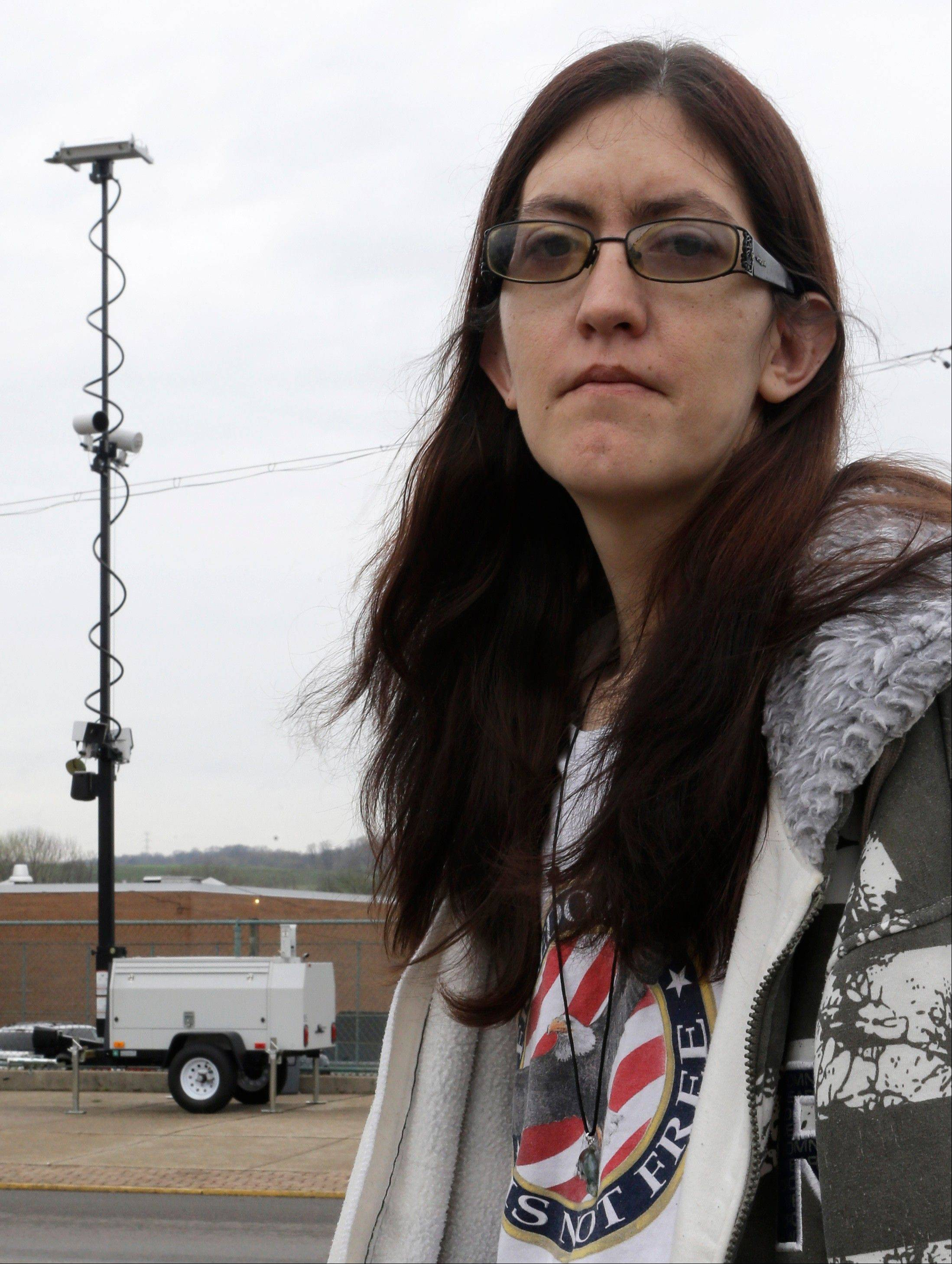 Holly Calhoun stands across the street from a tower of speed cameras located near the Elmwood Quick Stop she manages, in Elmwood Place, Ohio. Calhoun doesn't believe the speed cameras installed in the village were about safety.
