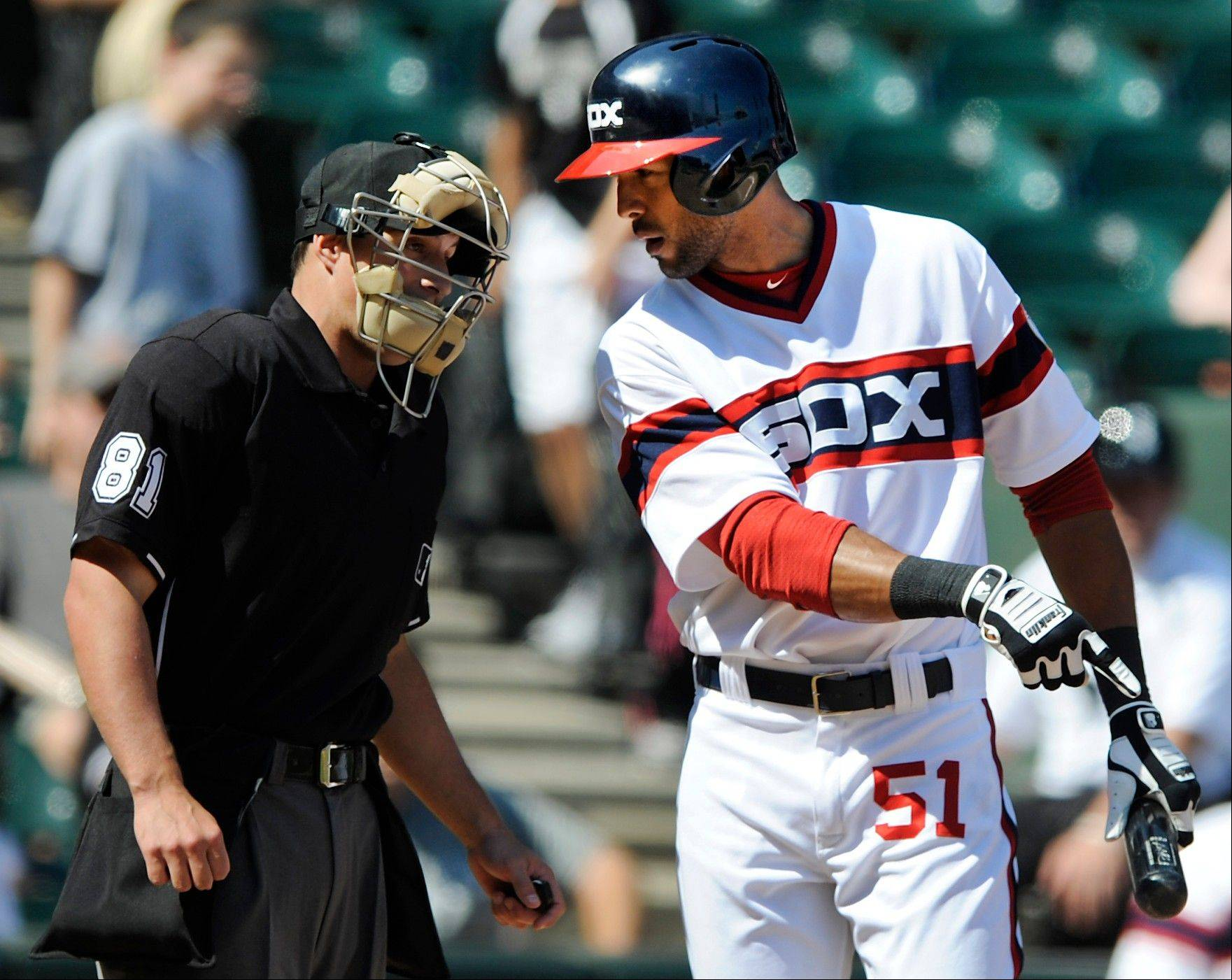 Alex Rios argues with umpire Quinn Wolcott after striking out to end the White Sox' 4-0 loss to the Indians on Sunday.
