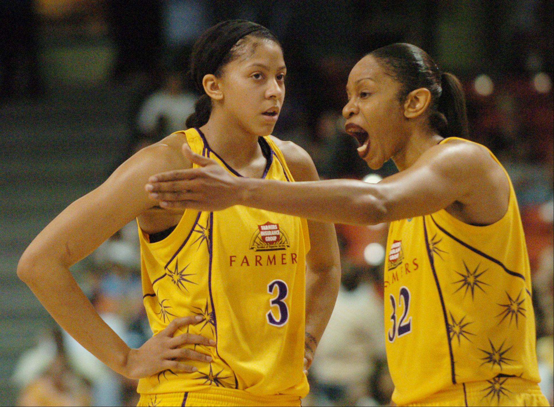JOE LEWNARD/jlewnard@dailyherald.com Candace Parker of the Los Angeles Sparks takes instruction from teammate Tina Thompson when the two were teammates. Thompson holds WNBA records for games played, minutes played and total points scored.