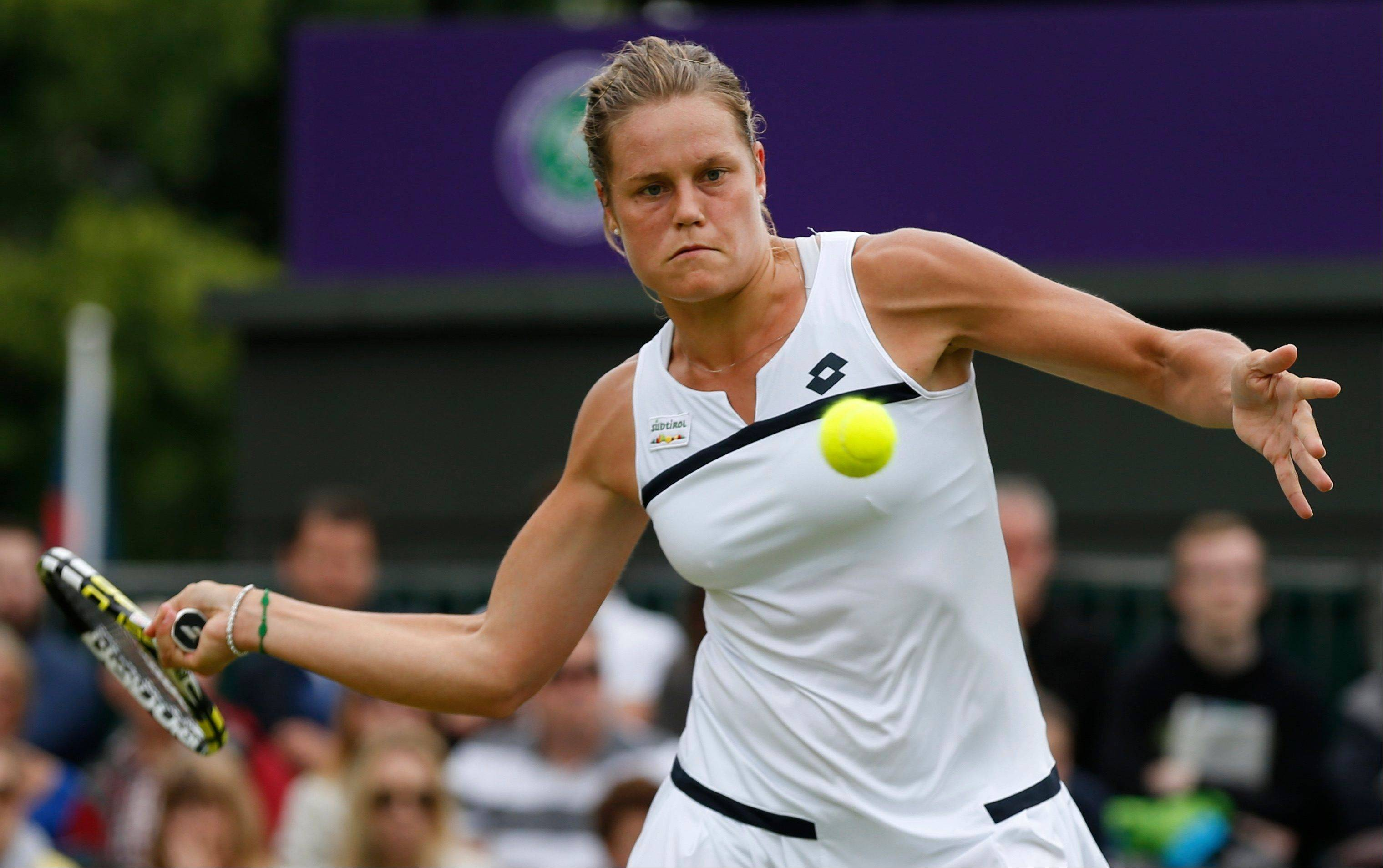 Karin Knapp of Italy returns to Michelle Larcher De Brito of Portugal during their women's singles match Friday at Wimbledon.