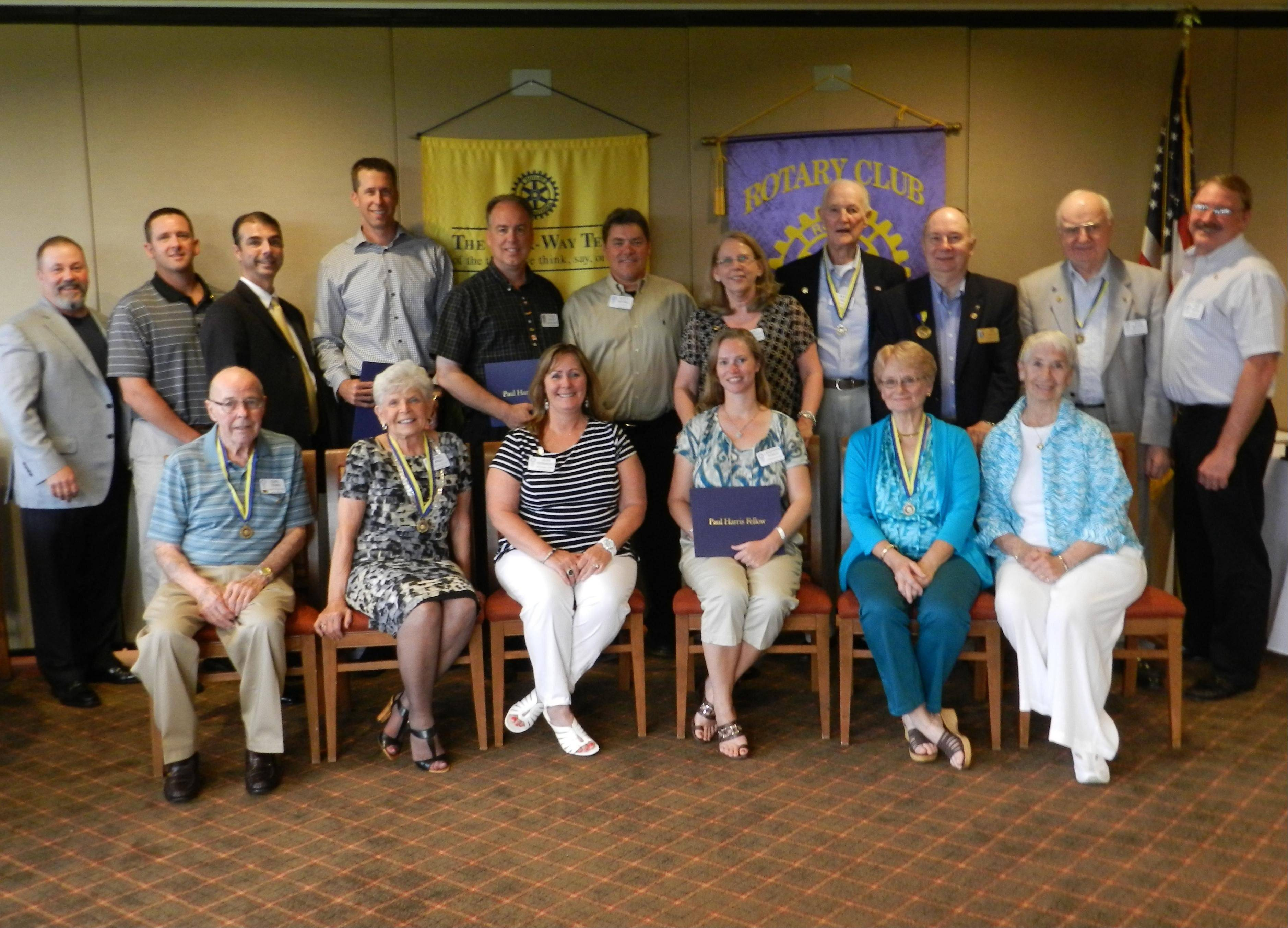 The Huntley Rotary Club recently awarded five Paul Harris Fellowships. Members include: first row, from left, Earl Ferris, Muriel Wright, Jean Hernandez, Leigh Ann Porsch, Kathy Uszler and Maxine Higgins; and back row, Jim Vaccaro, Chad Alexander, Bill Jorgensen, Chad Binger, Thom Palmer, Scott Mitchell, Nancy Topalovich, Warren Higgins, Jim Uszler, Rudi Welvers and Jim Drendel.