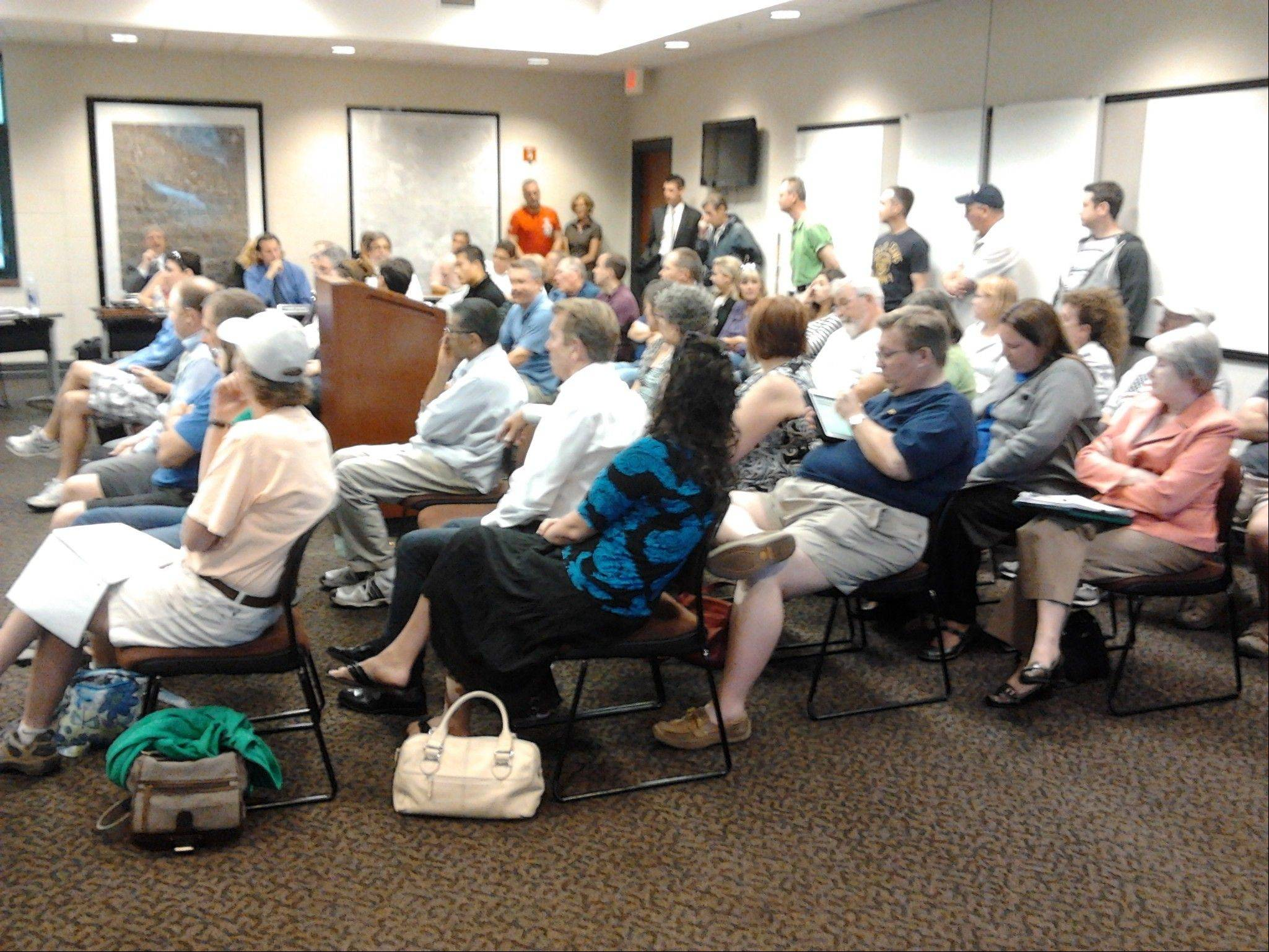 About 50 residents attended Monday's Lake Zurich village board meeting with concern over last week's flooding.