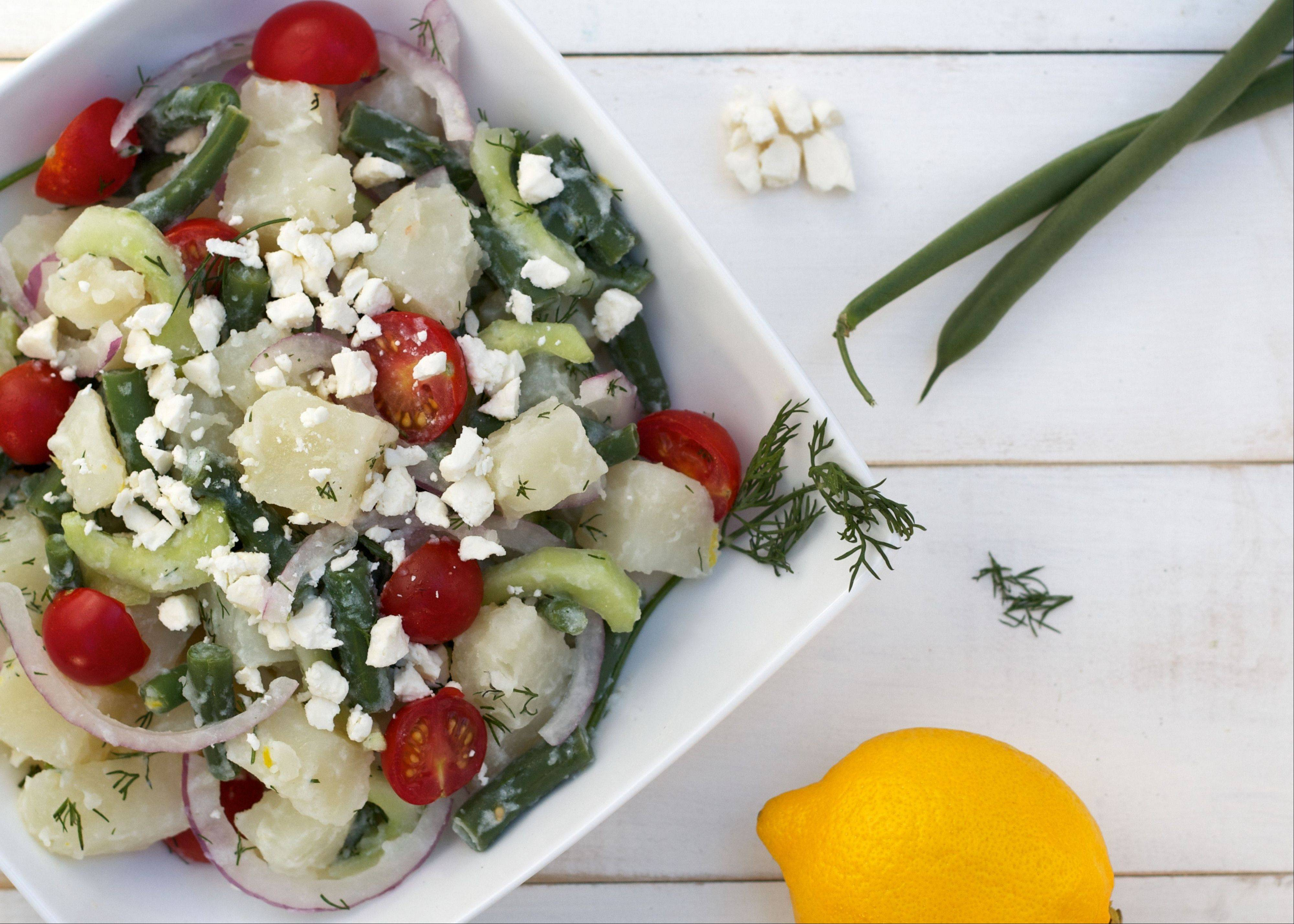 Feta cheese, tomatoes and fresh dill give potato salad a Greek flare.