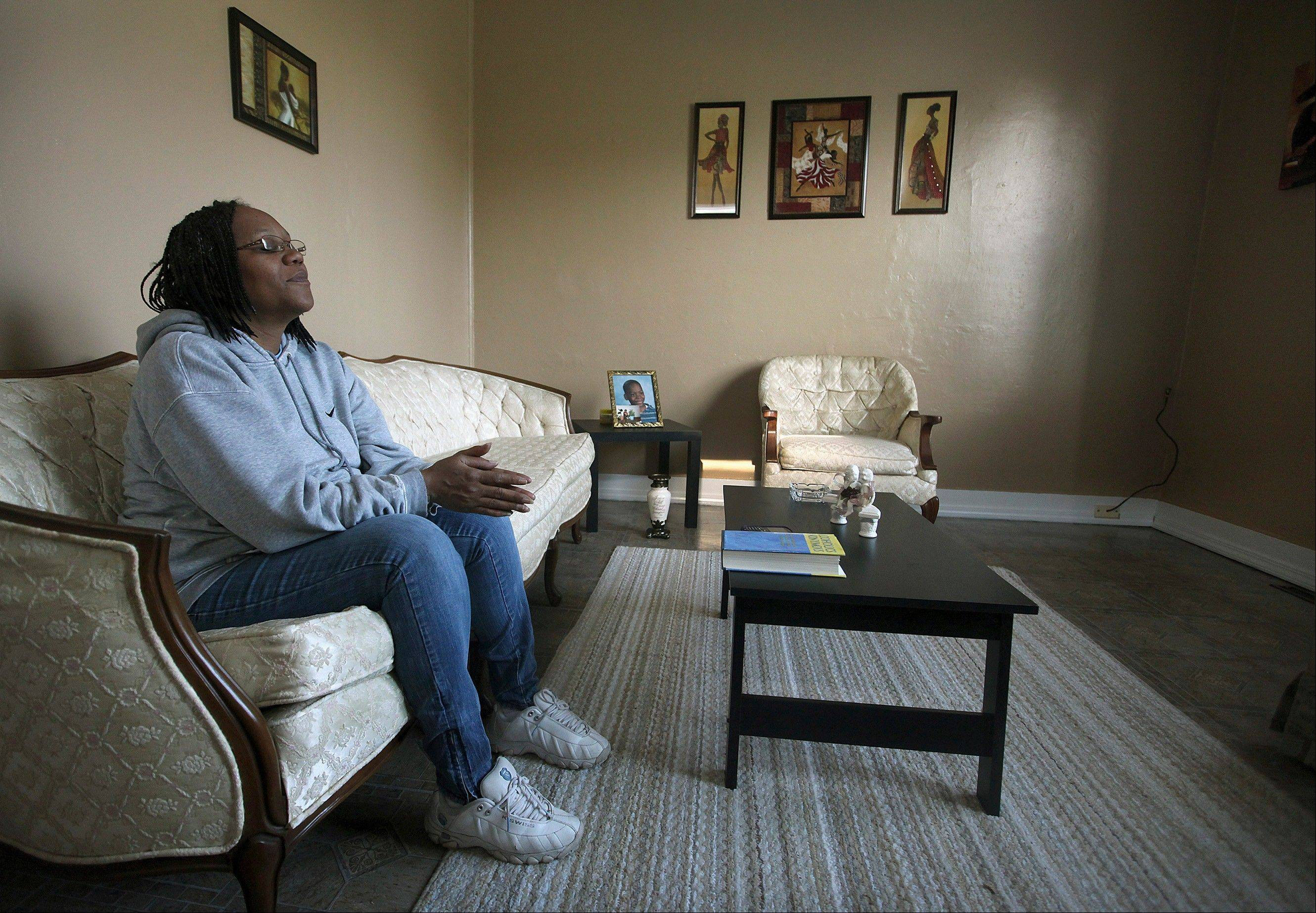 Recovering cocaine addict Maria Buchanan sits quietly in her living room praying and meditating, as she does each morning in Quincy, Ill. Maintaining spiritual fitness is a big part of Buchanan's recovery program.