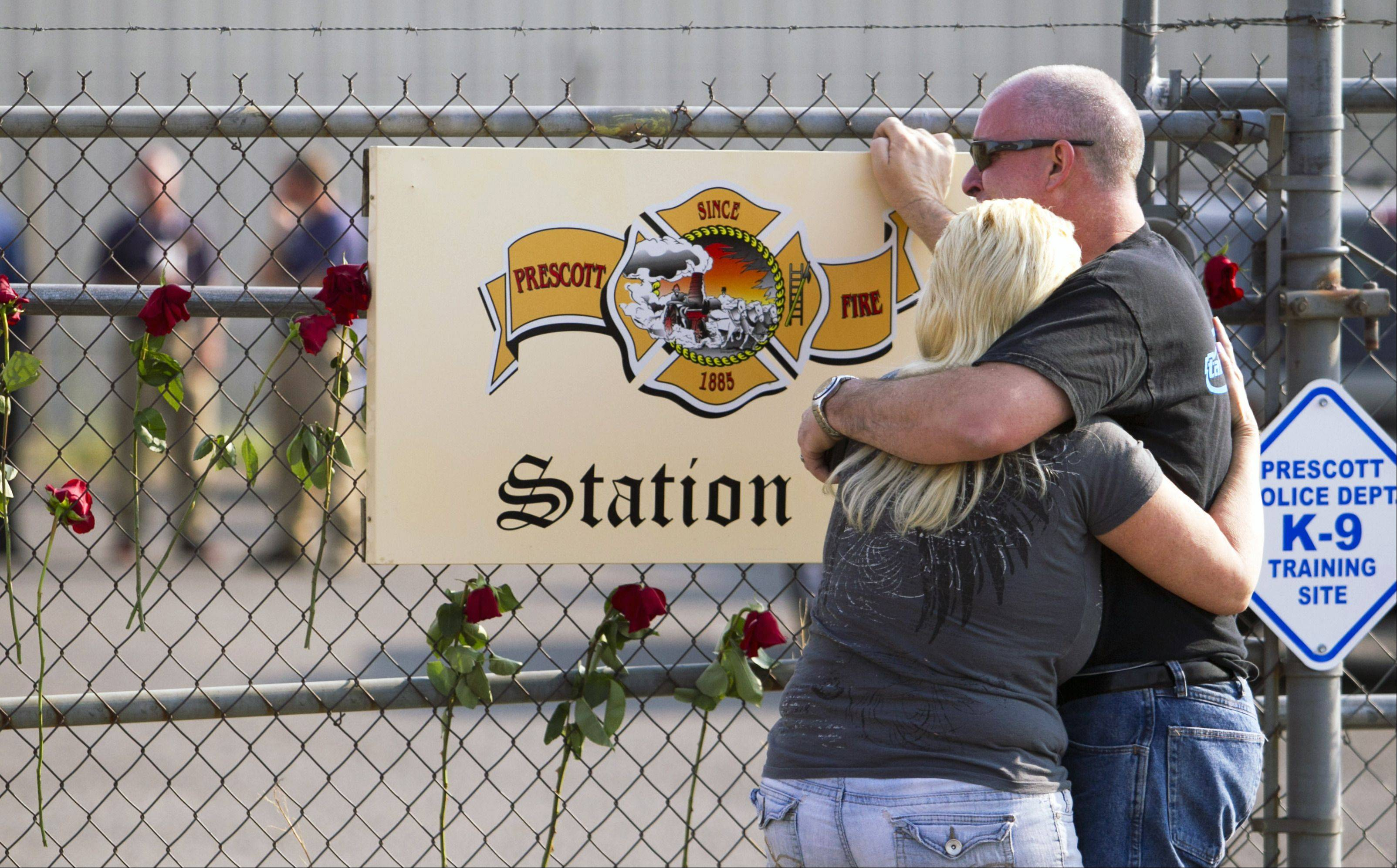 David Turbyfill, father of firefighter Travis Turbyfill, who was killed fighting the Yarnell Hill Fire, is comforted by his wife, Shari Turbyfill in front of Prescott Fire Station 7 on Monday, July 1, 2013 in Prescott, Ariz.