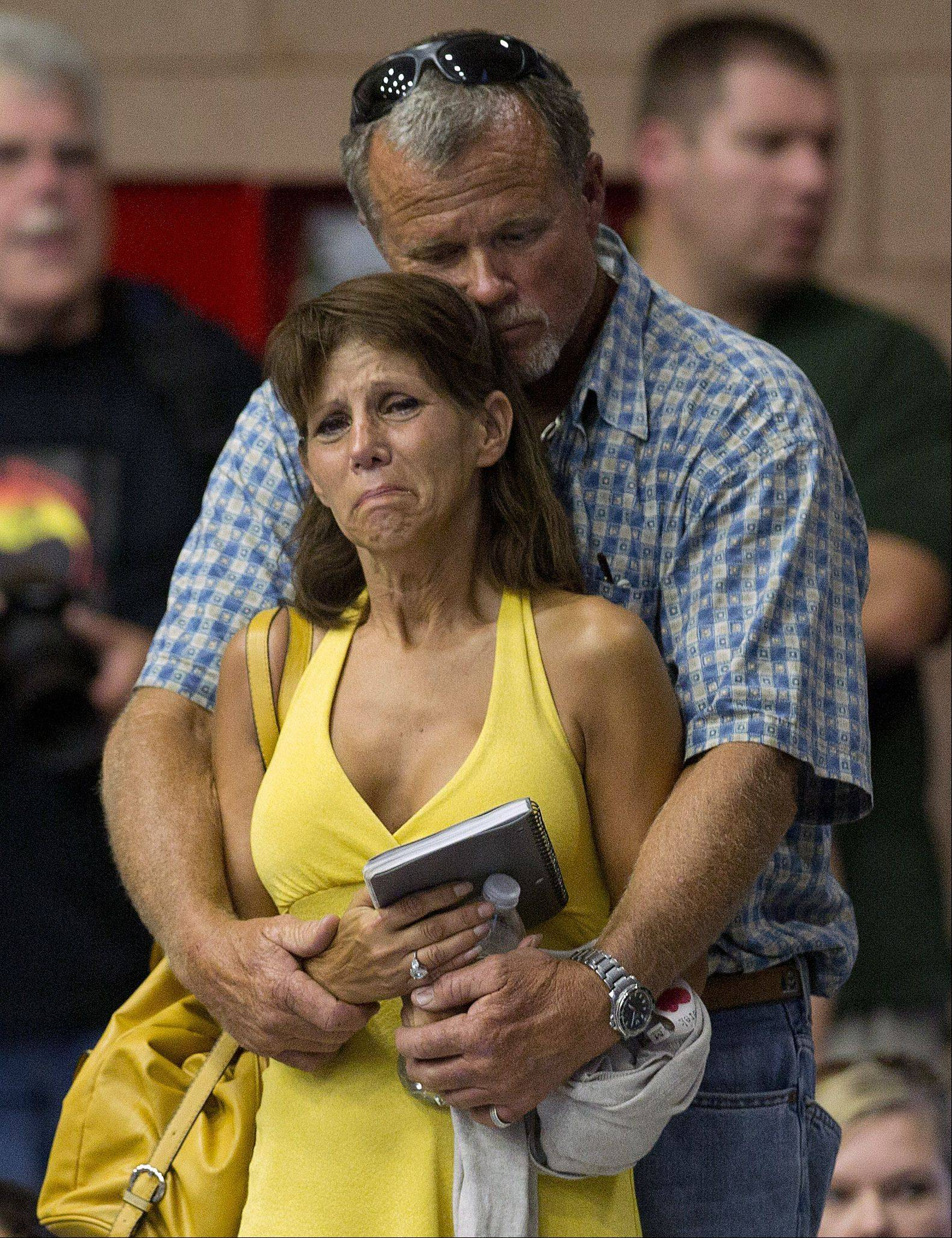 Marsha McKee and Stanley Nesheim react during a memorial service for 19 firefighters of the Granite Mountain Hotshot Crew, Monday, July 1, 2013 in Prescott, Ariz. McKee is the mother of one of the Hotshots who were killed .
