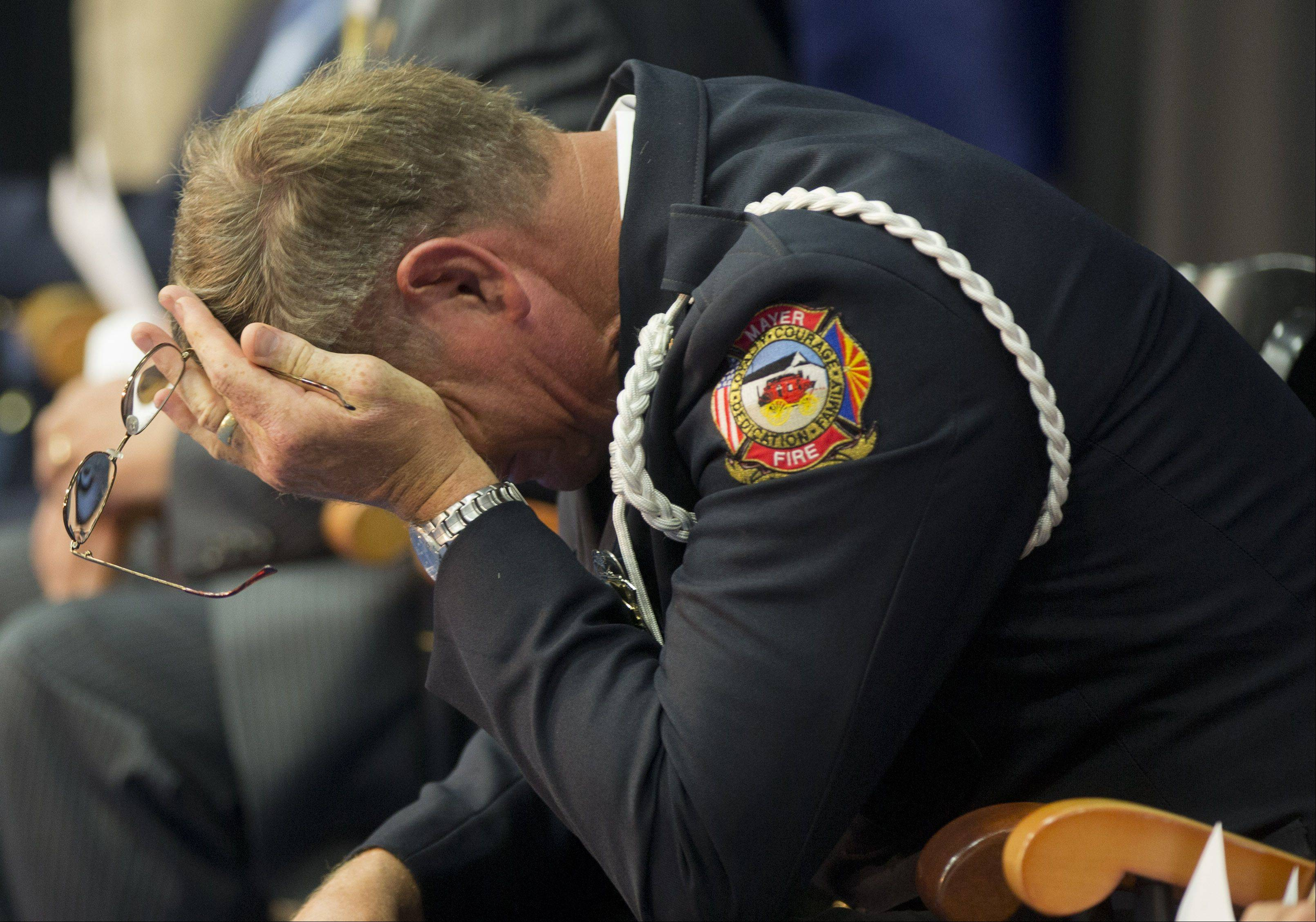 Mayer fire department chaplain Rev. Bob Ossler, reacts during a memorial service for 19 wildland firefighters, Monday, July 1, 2013 in Prescott, Ariz.