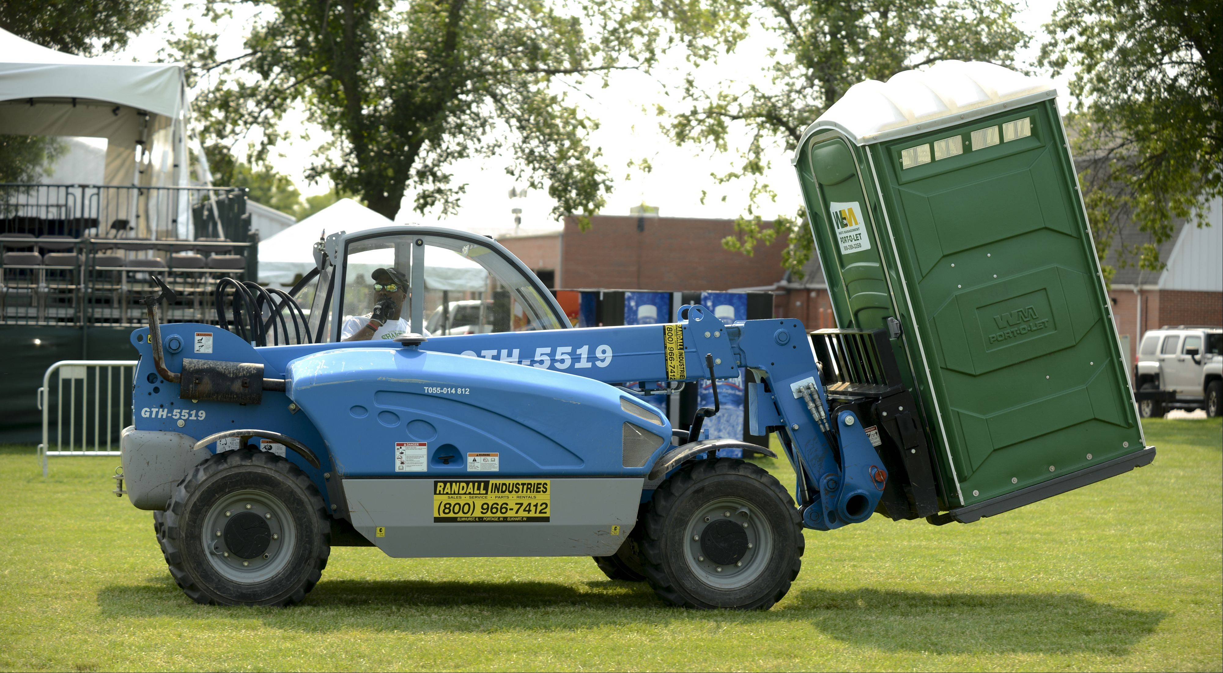 Portable toilets are moved into place Monday in preparation for Naperville's 26th annual Ribfest, which begins at 4 p.m. Wednesday in Knoch Park, 724 S. West St.
