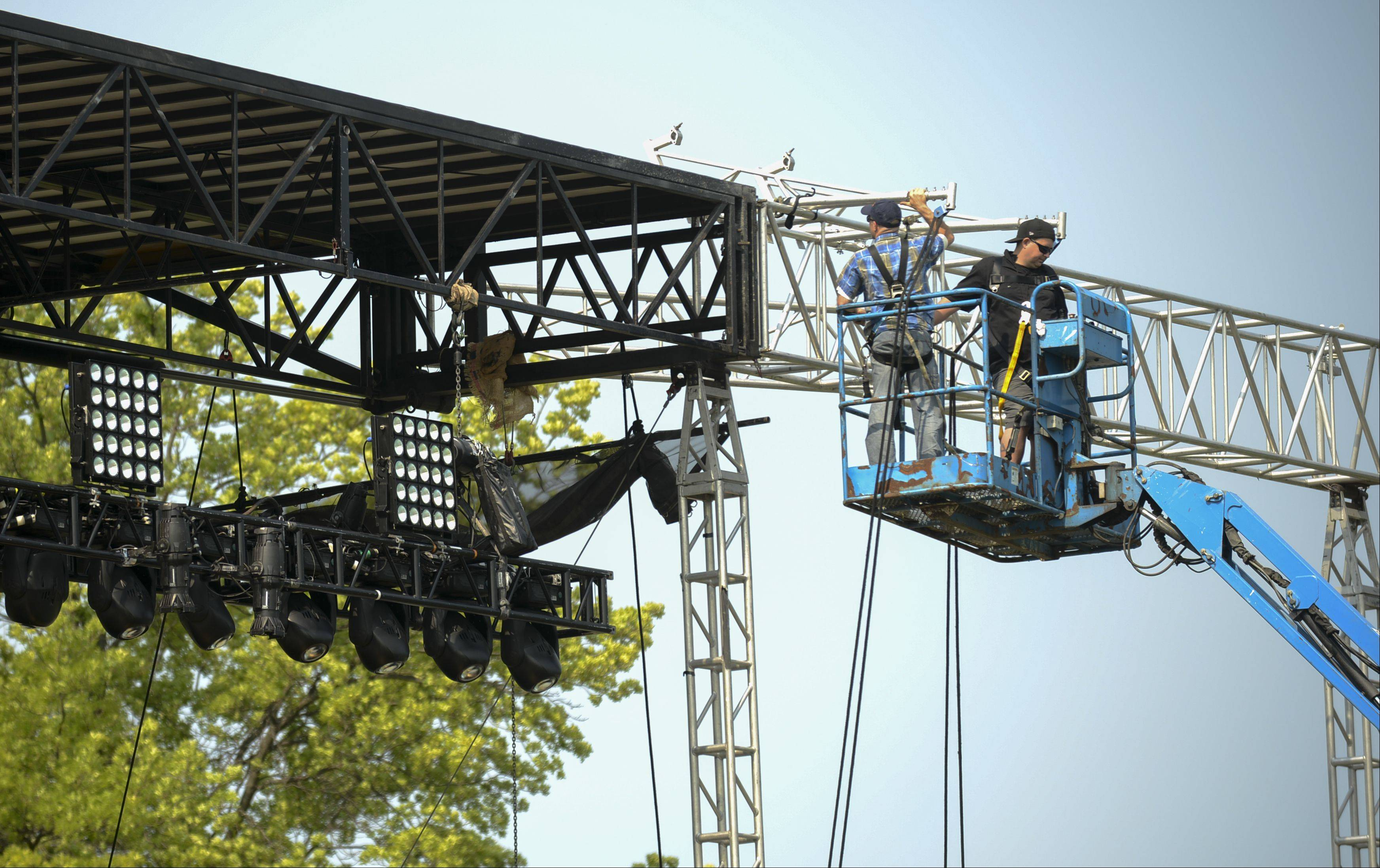 The main stage at the Naperville Exchange Club's 26th annual Ribfest was set up Sunday, but workers continue stage preparations Monday at Knoch Park in advance of the festival's 4 p.m. Wednesday opening.
