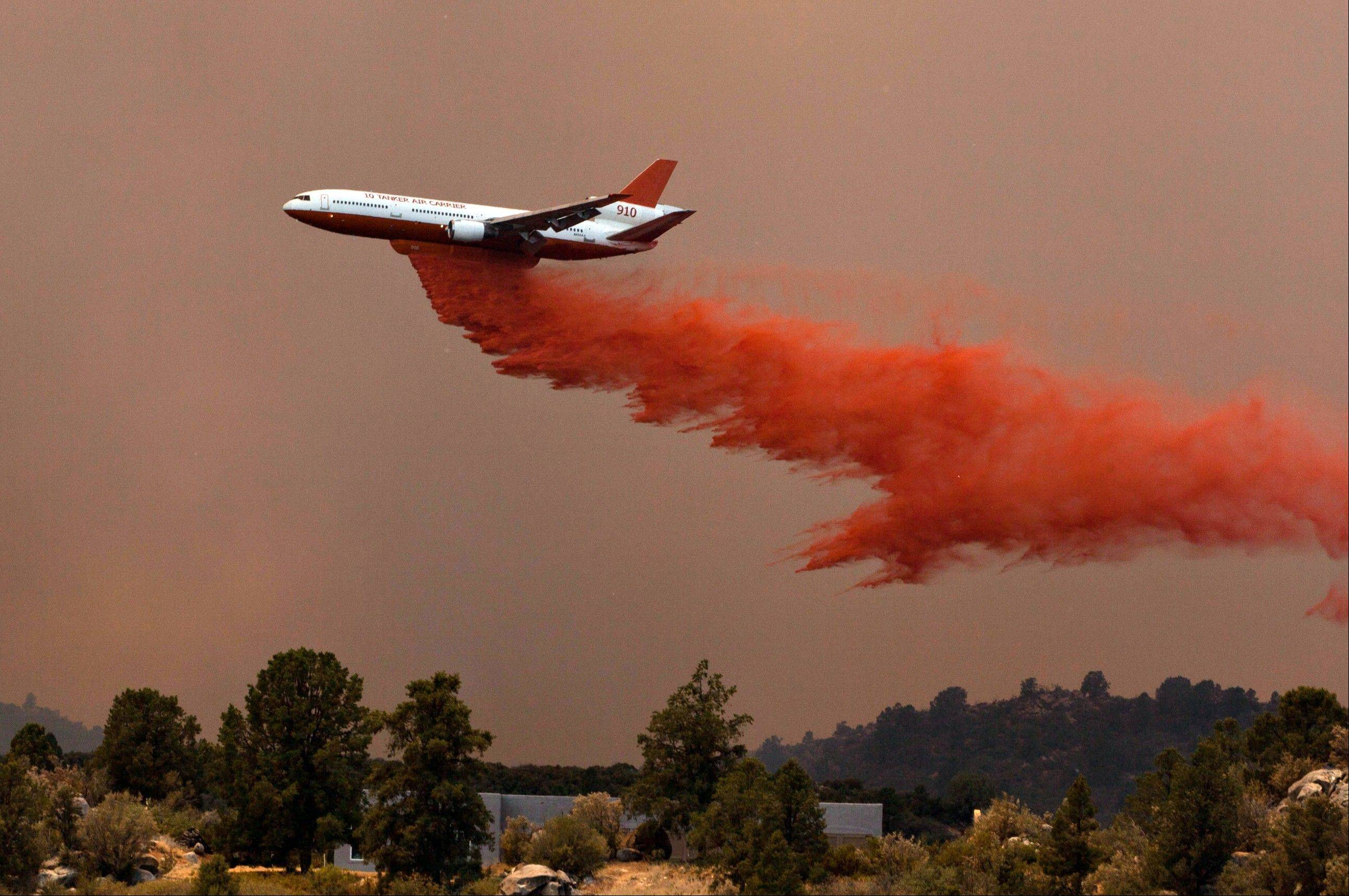 Tanker 910 makes a retardant drop Yarnell Hill Fire to help protect the Double Bar A Ranch near Peeples Valley, Arizona, Sunday, June 30, 2013. The lightning caused blaze began on Yarnell Hill on Sunday.