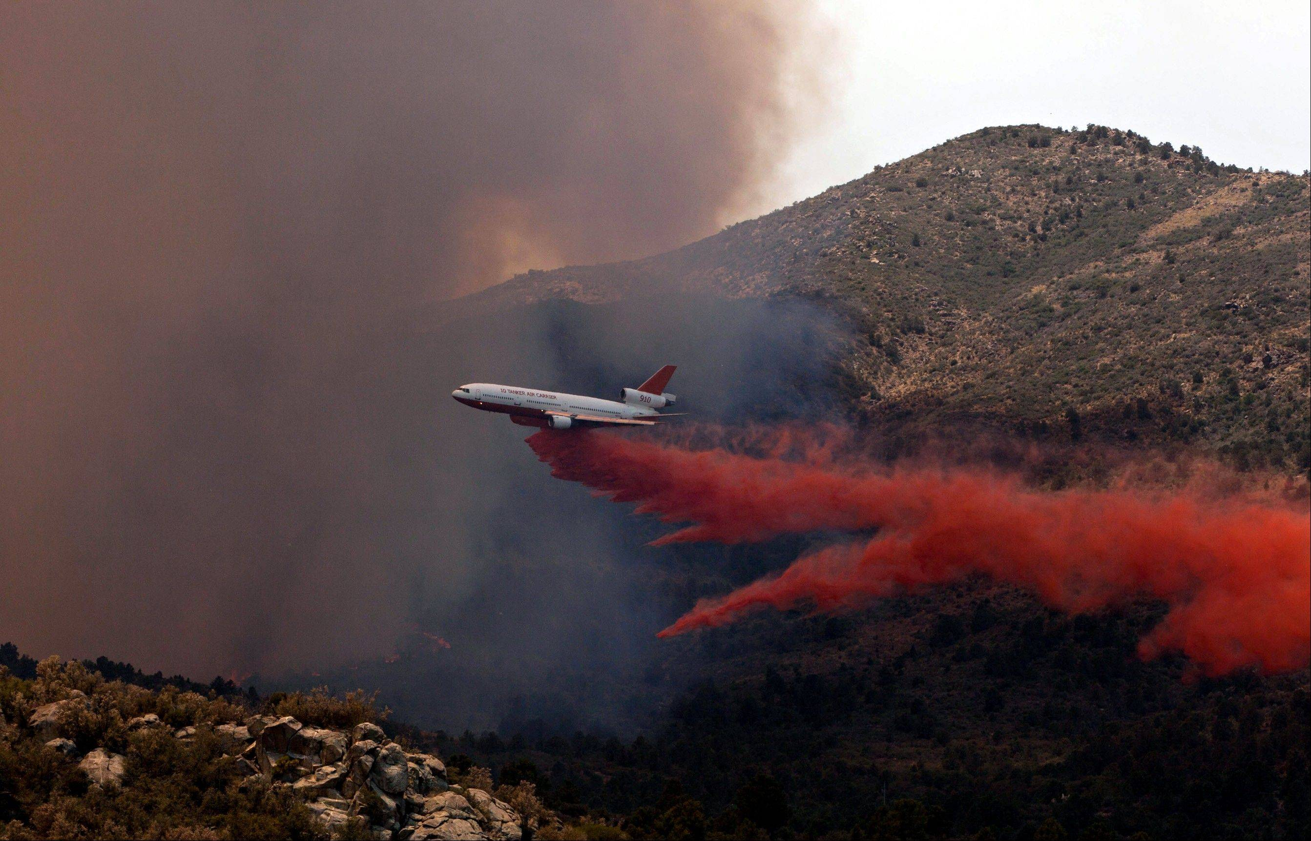 Tanker 910 makes a retardant drop on the Yarnell Hill Fire to help protect the Double Bar A Ranch near Peeples Valley, Arizona, Sunday, June 30, 2013. The lightning caused blaze began on Yarnell Hill on Sunday.