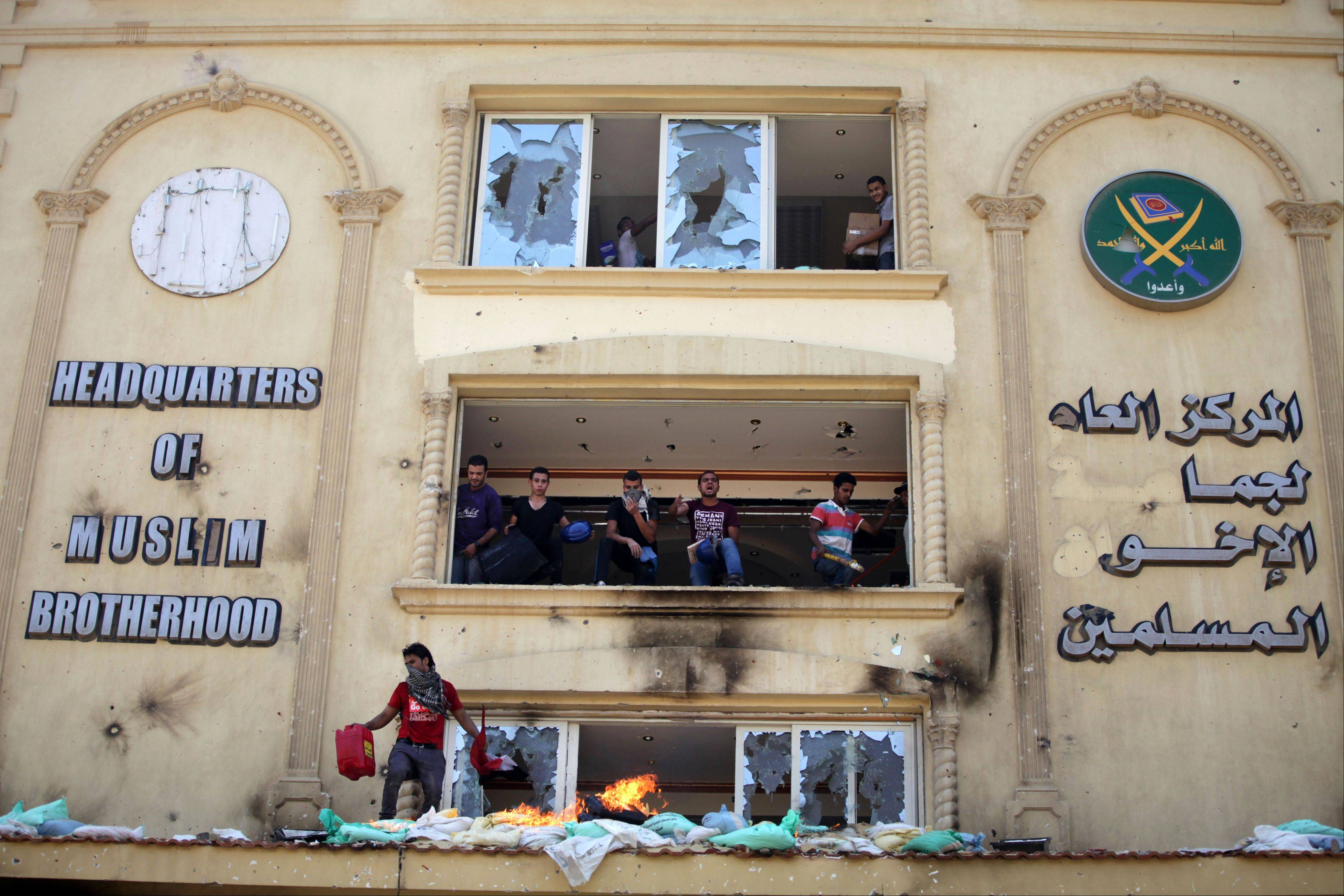 Protesters ransack the Muslim Brotherhood headquarters in the Muqatam district in Cairo Monday in an attack that could spark more violence as demonstrators gear up for a second day of mass rallies aimed at forcing the Islamist leader from power.