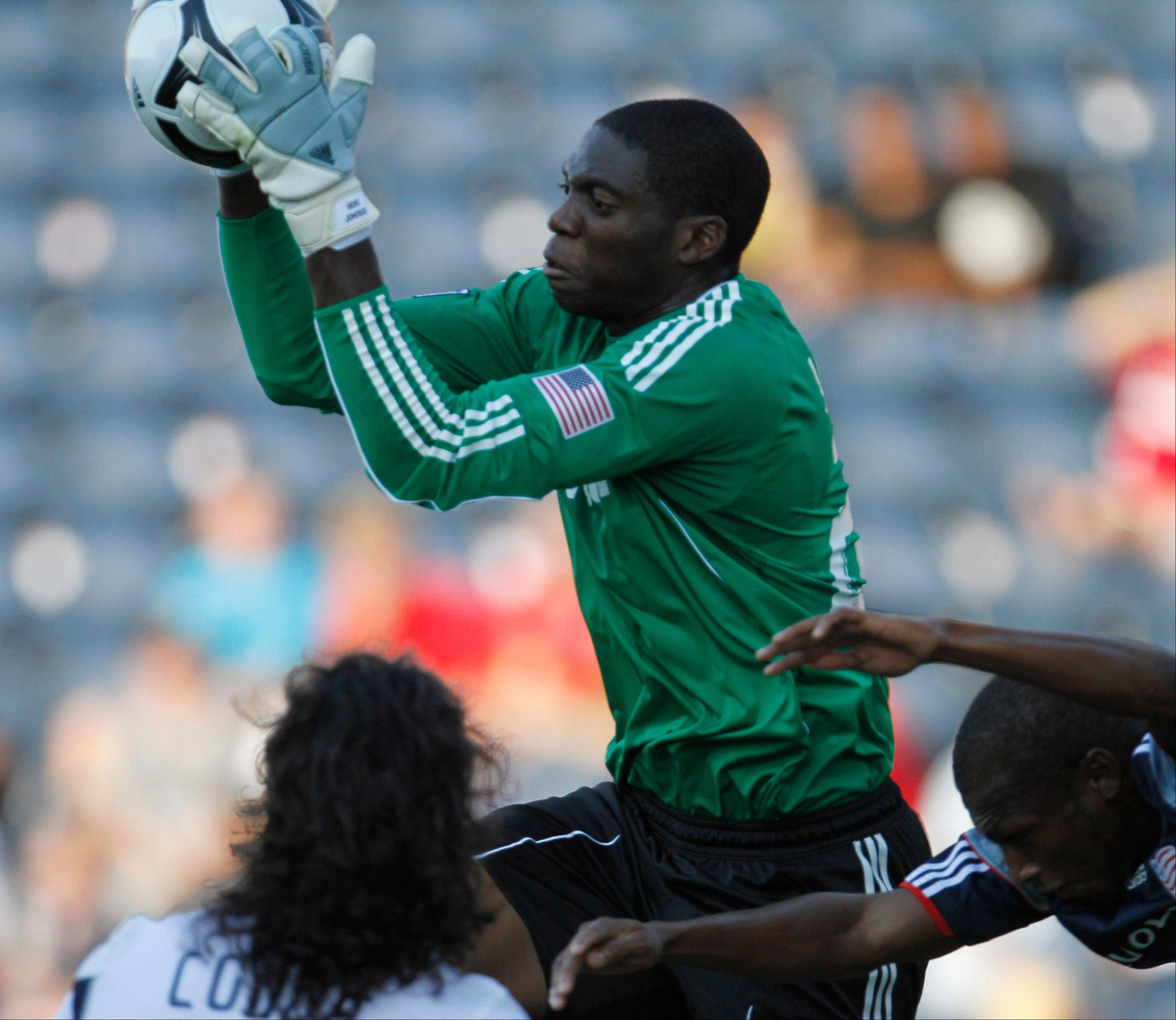 Fire goalkeeper Sean Johnson saves a shot by New England Revolution midfielder Kenny Mansally during the 2010 season. With Johnson honoring national team duty, Paolo Tornaghi gets the start Wednesday against the San Jose Earthquakes.