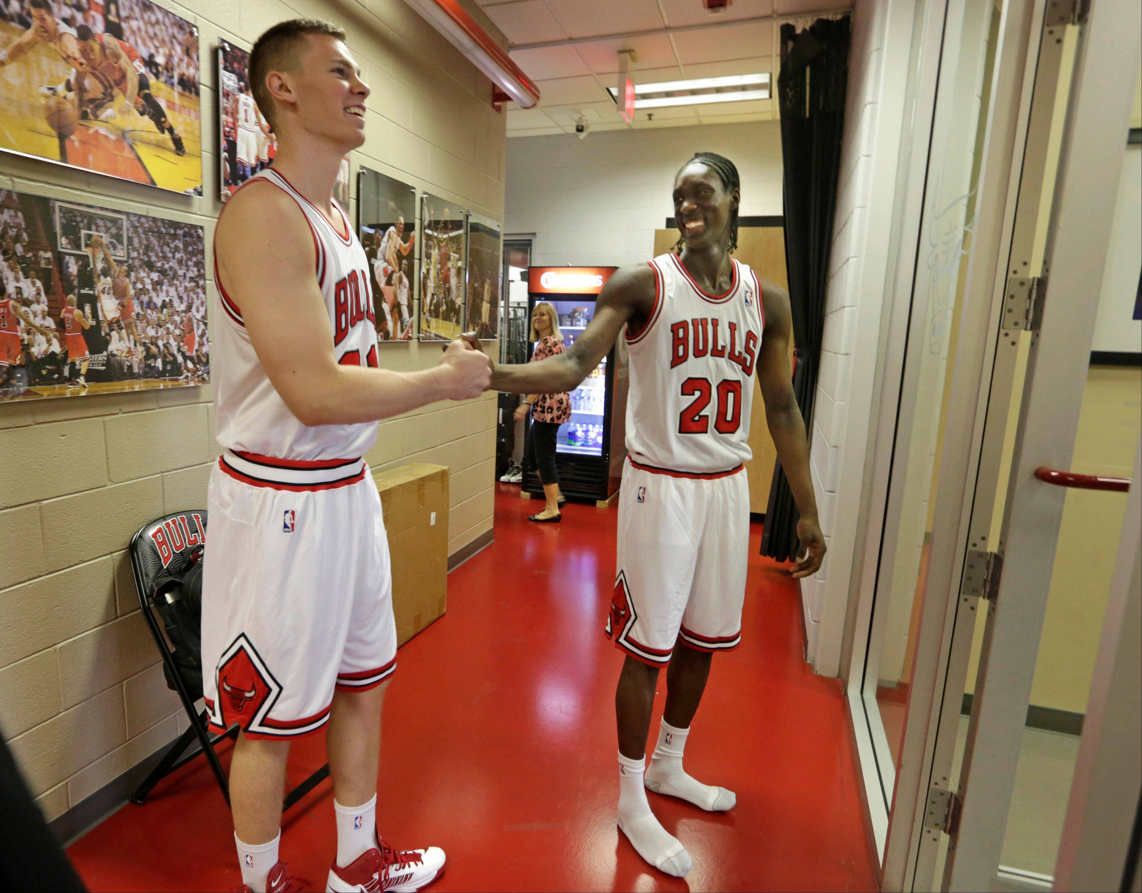 Bulls draft picks Erik Murphy, left, and Tony Snell, meet in the hallway at the Berto Center on Monday after changing into their new uniforms for the first time. The Bulls took Snell (New Mexico) with the 20th pick and Murphy (Florida) with the 49th.