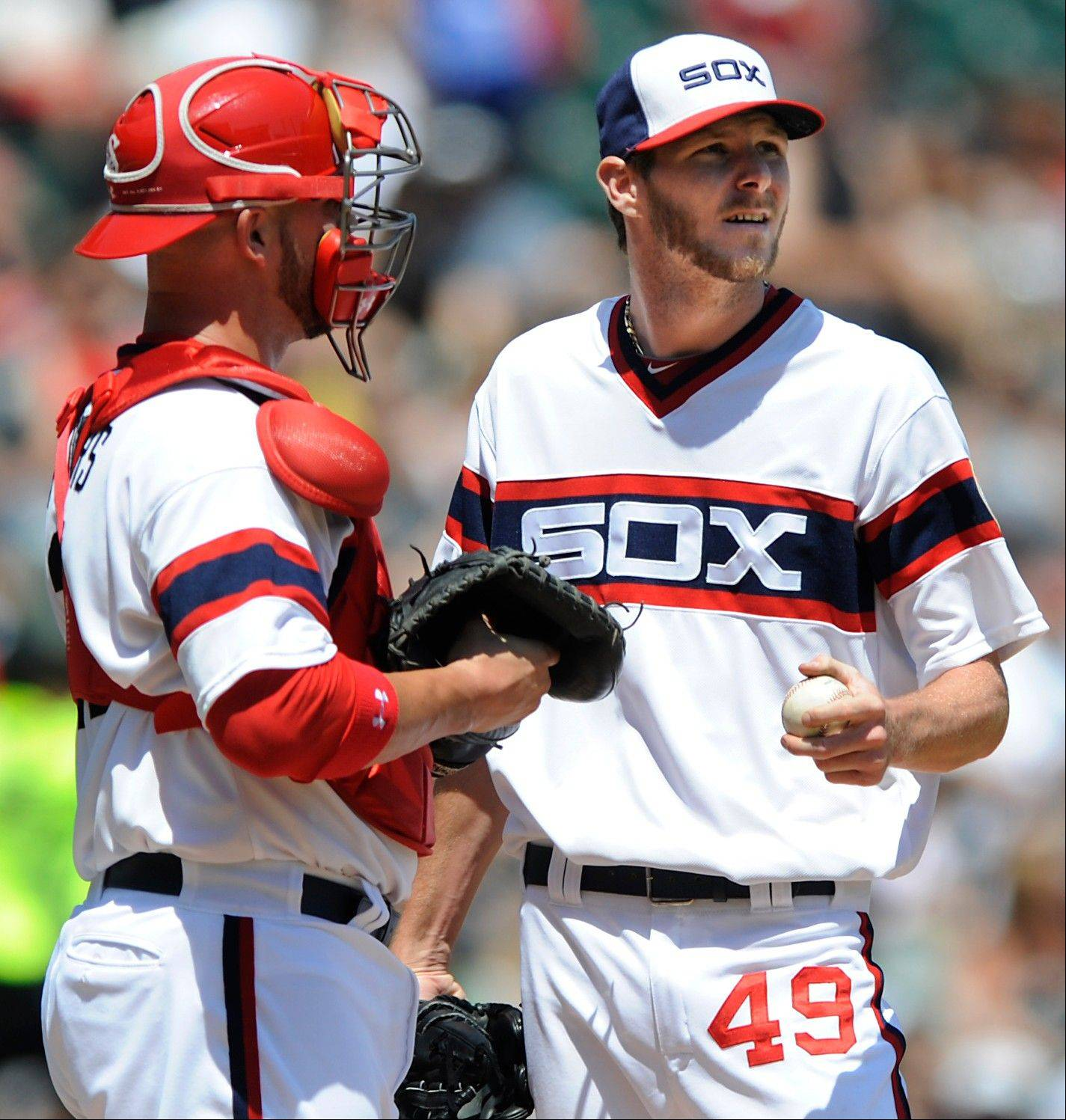 White Sox starting pitcher Chris Sale talks with catcher Tyler Flowers after giving up 2 runs in the fourth inning Sunday at U.S. Cellular Field.
