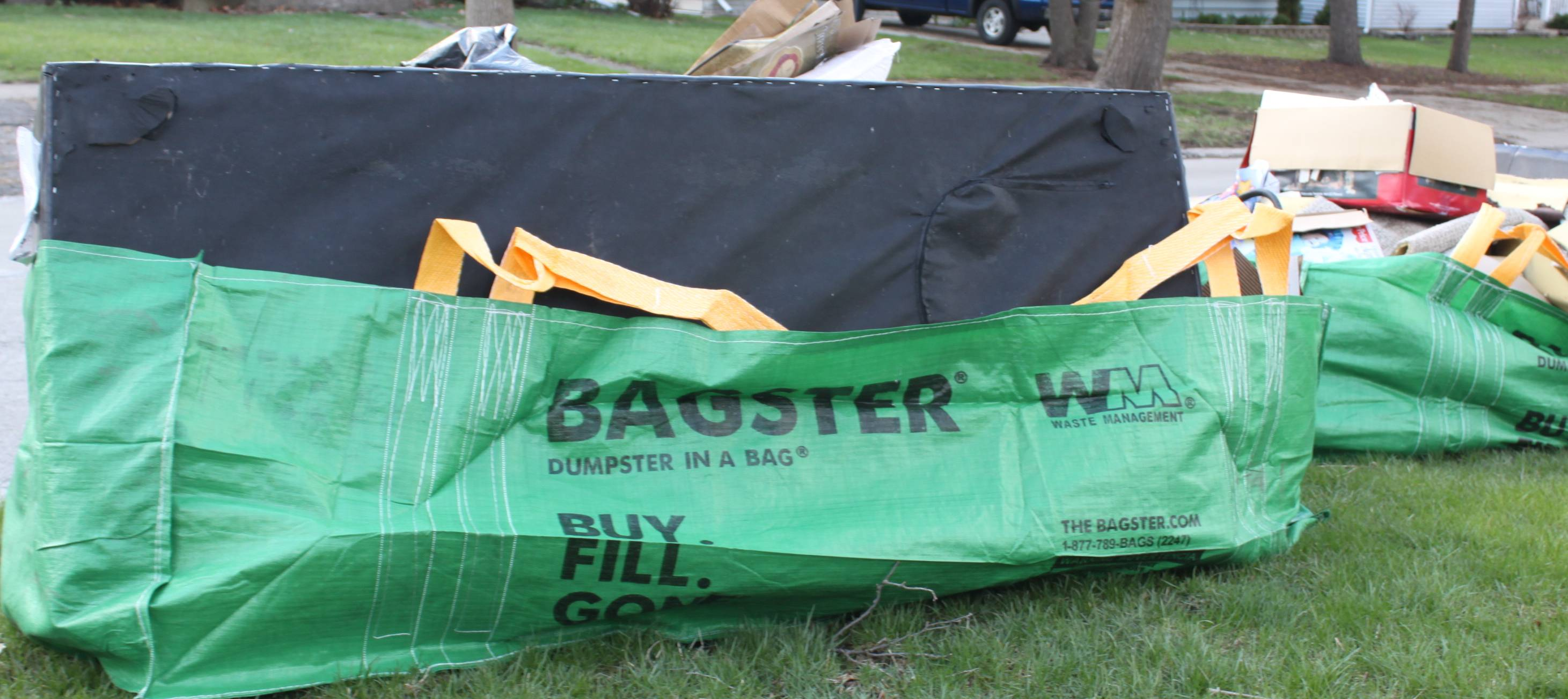 The Bagster� Dumpster in a Bag� awaits collection by Waste Management after recent flooding in western suburbs.