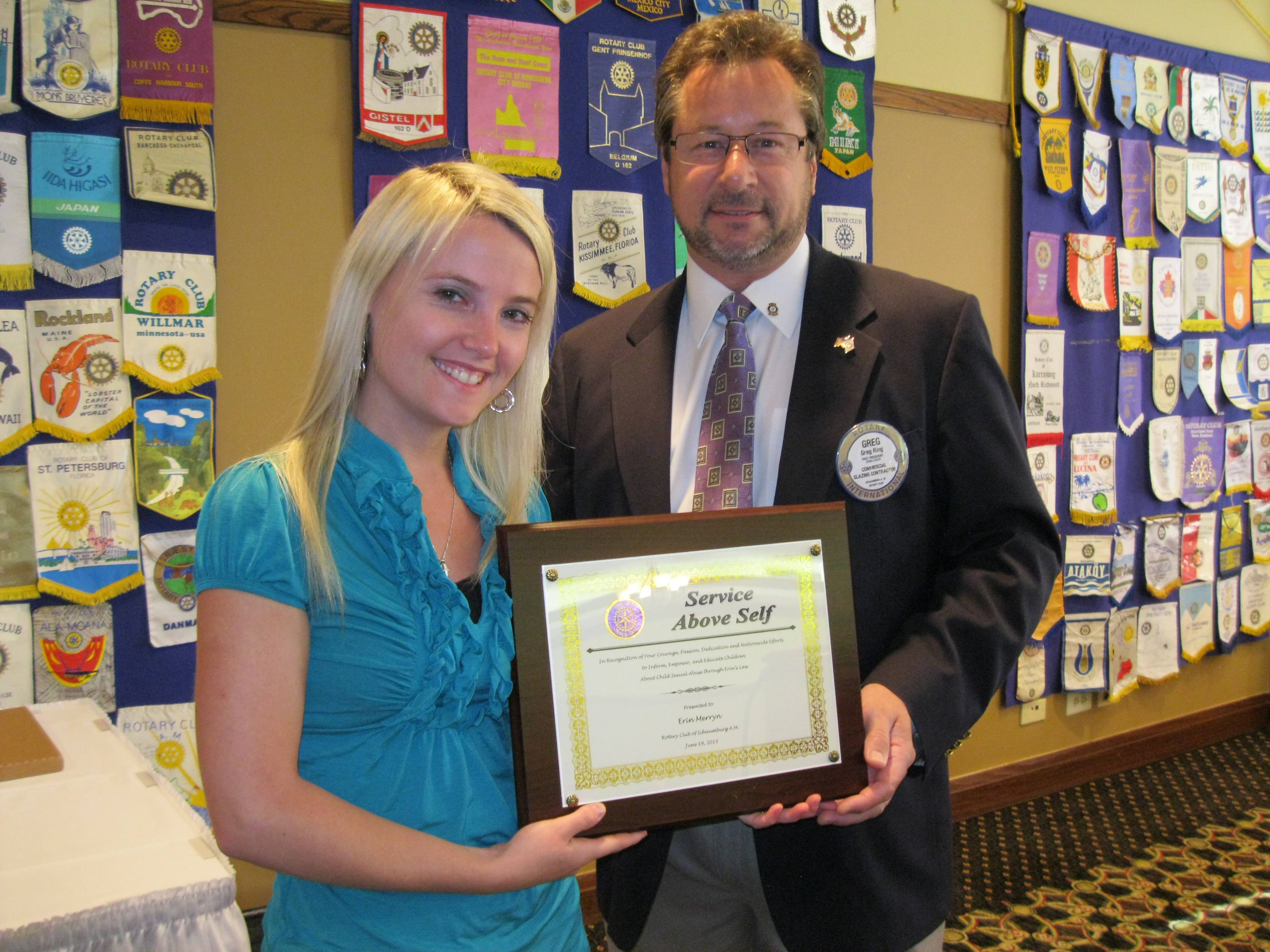 From left to right -- Erin Merryn receives Service Above Self Award from Schaumburg A.M. Rotary president Greg Ring